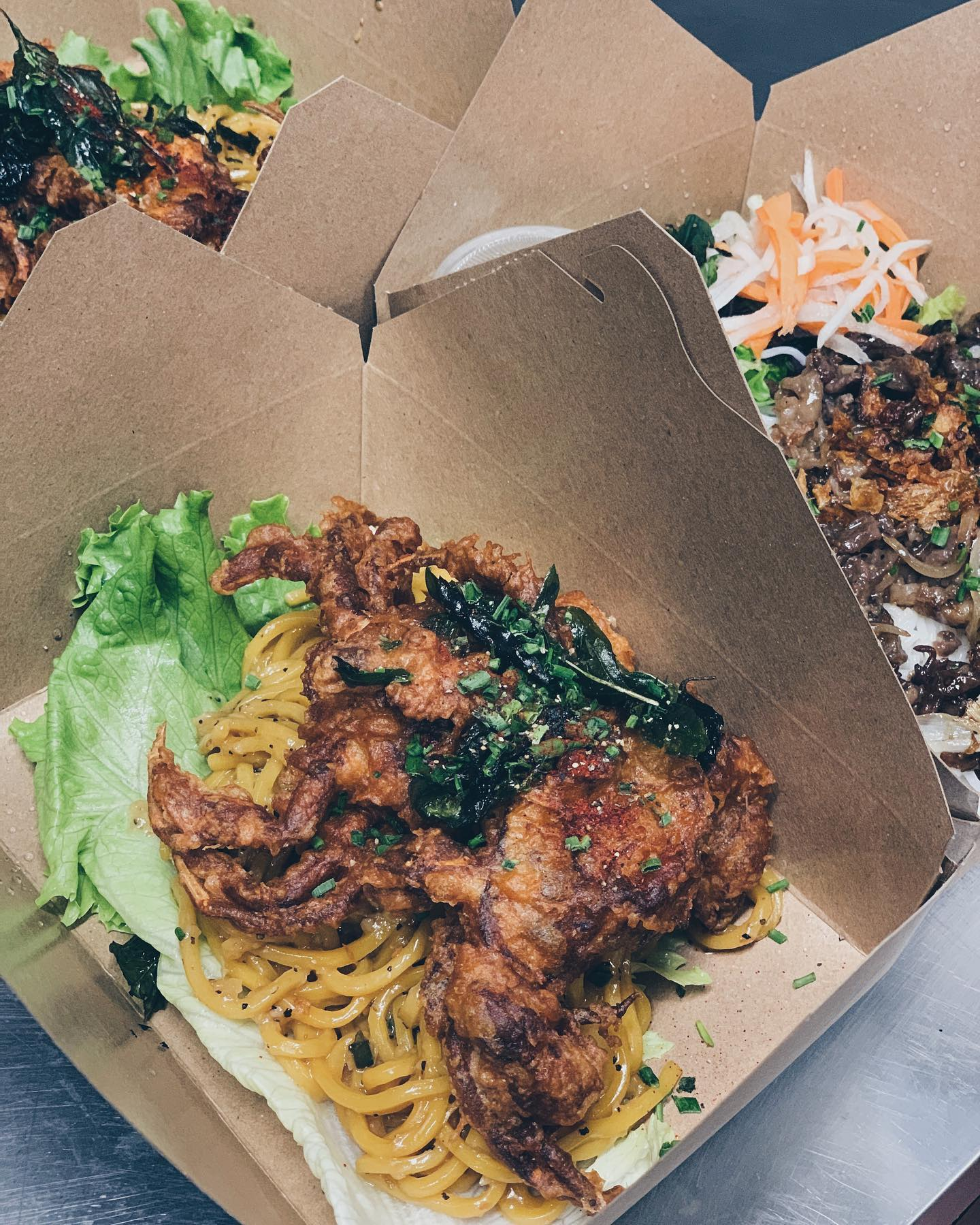 Soft shell crab with black pepper noodles at Ba Sa in a takeout container