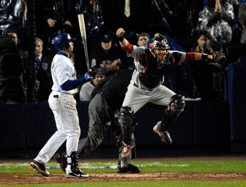 St. Louis Cardinals' catcher Yadier Molina rejoices after Ne
