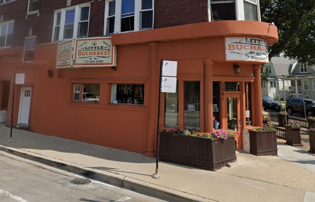 The brick exterior of a corner restaurant