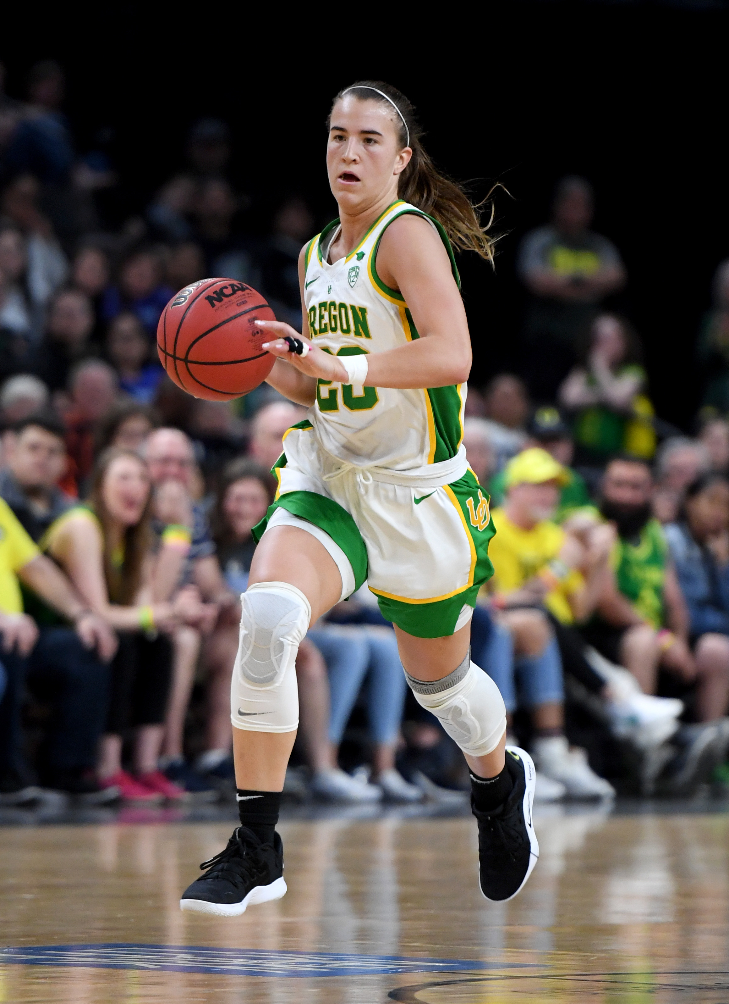Sabrina Ionescu of the Oregon Ducks brings the ball up the court against the Stanford Cardinal during the championship game of the Pac-12 Conference women's basketball tournament at the Mandalay Bay Events Center on March 8, 2020 in Las Vegas, Nevada. The Ducks defeated the Cardinal 89-56.