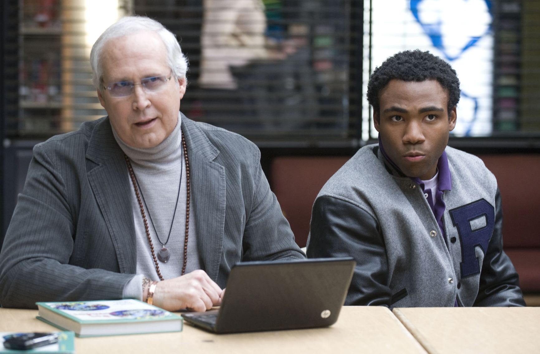 Chevy Chase and Donald Glover as Pierce Hawthorne and Troy Barnes, respectively, in the TV show Community