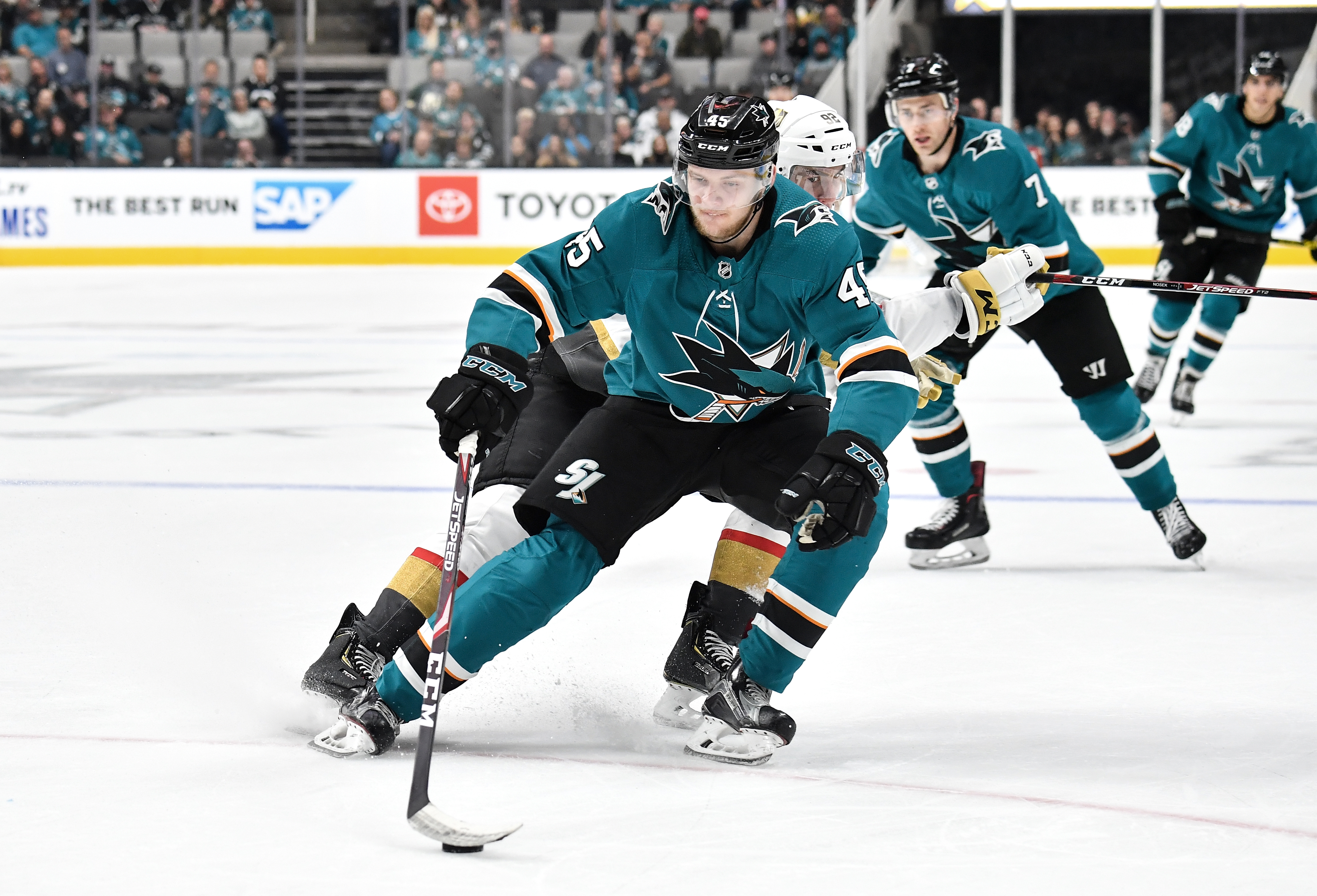 SAN JOSE, CA - OCTOBER 04: Lean Bergmann #45 of the San Jose Sharks skates ahead with the puck against the Vegas Golden Knights at SAP Center on October 4, 2019 in San Jose, California.
