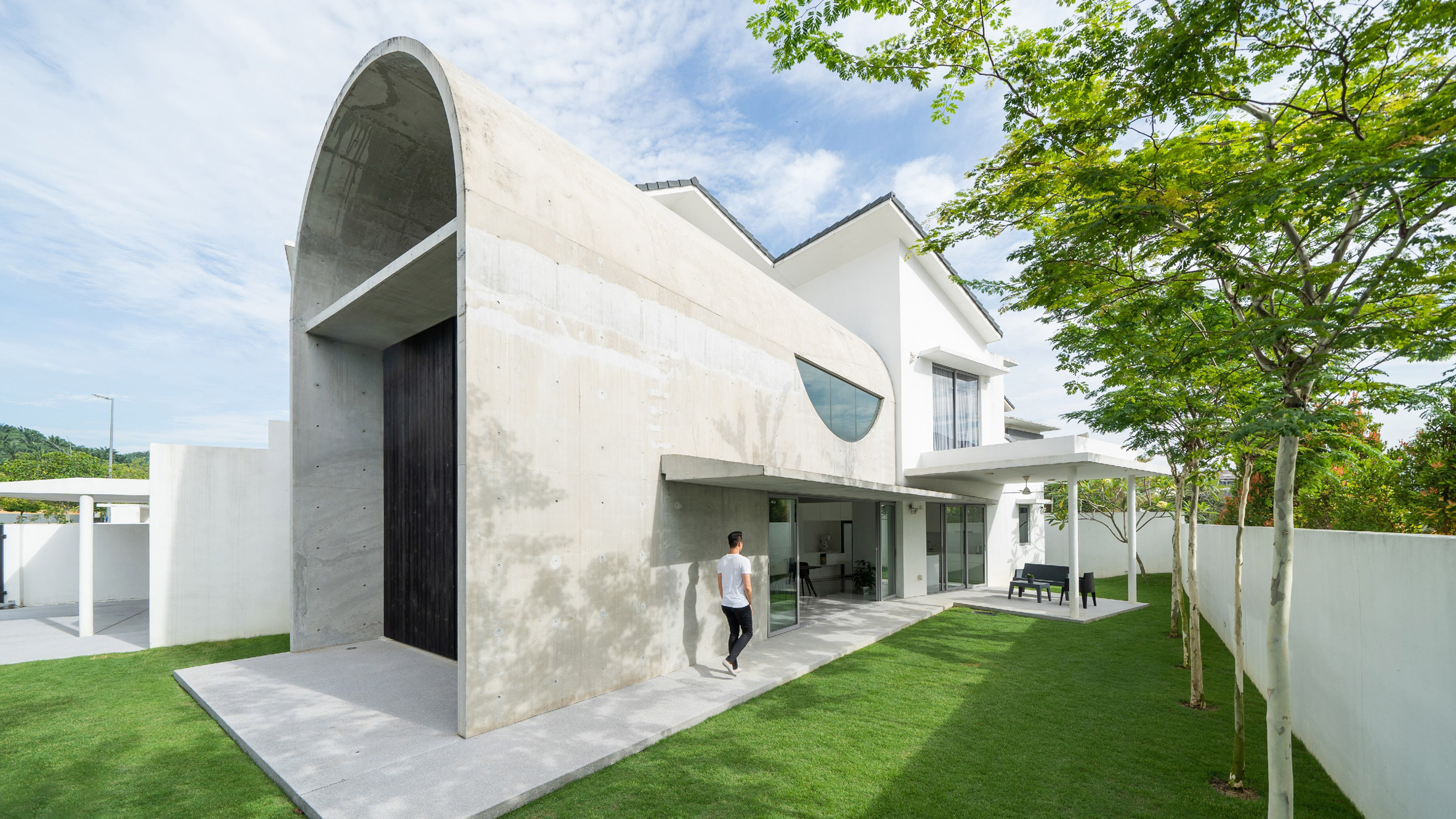 Concrete house with large barrel arch.