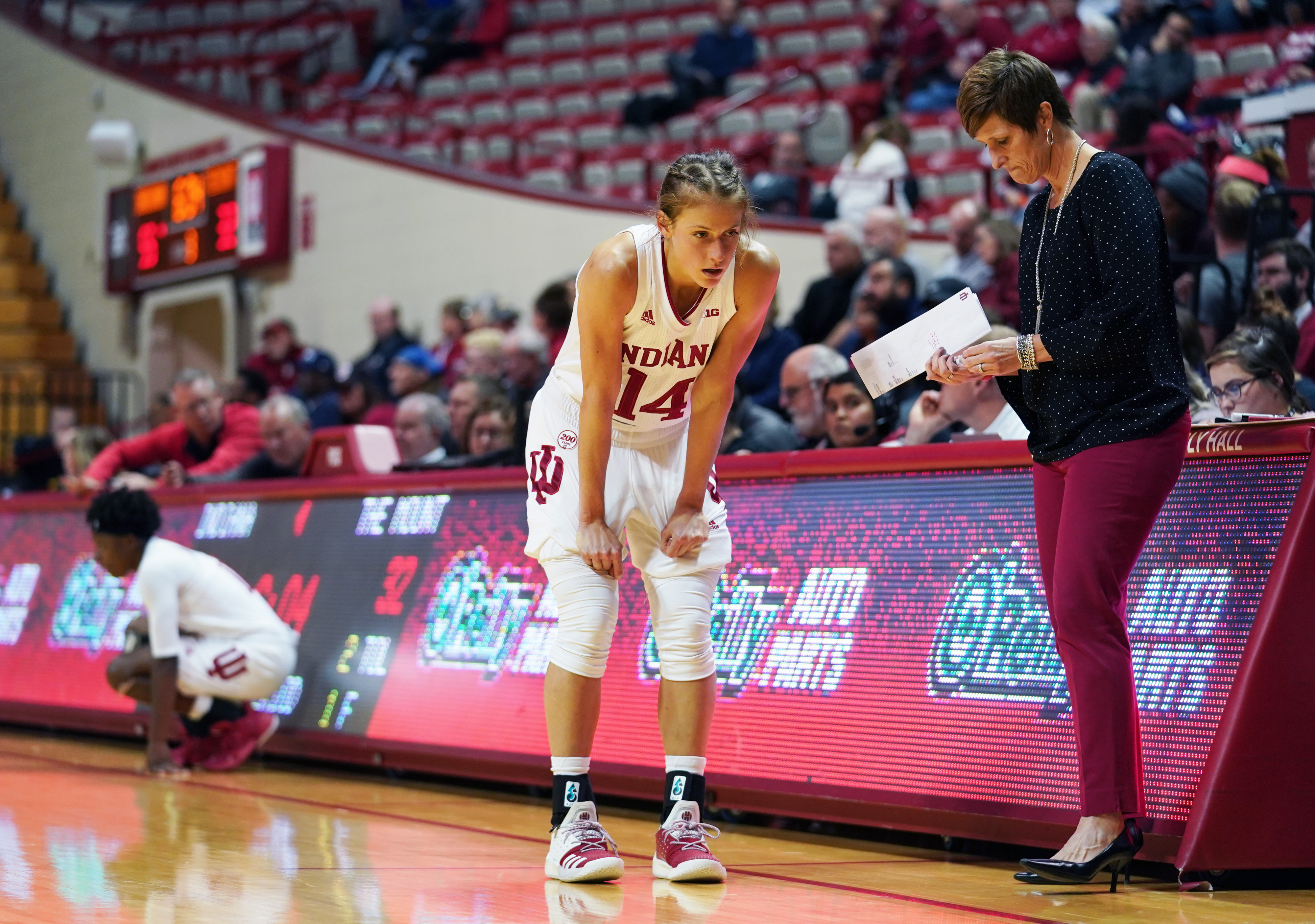 Indiana Hoosiers Ali Patberg (14) speaks with the head coach...