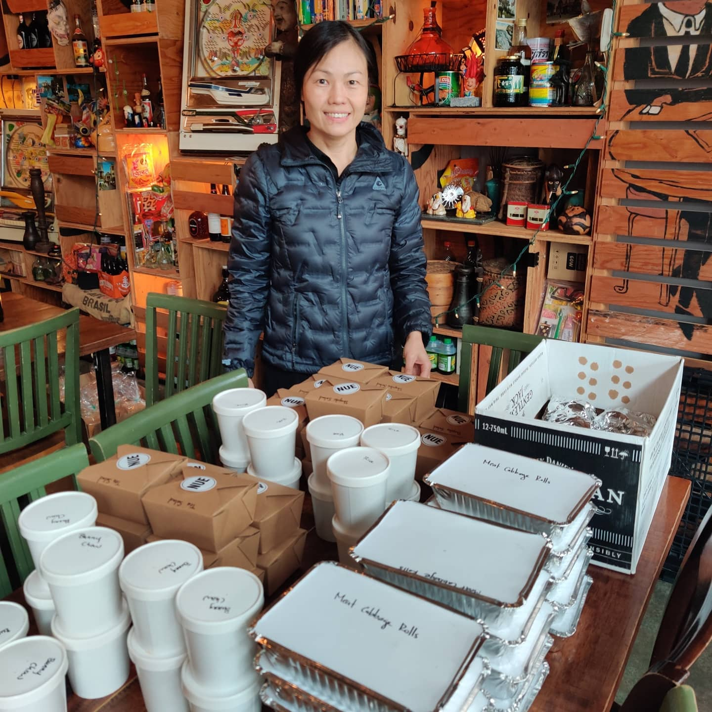 Nue co-owner Uyen Nguyen poses with donated food on its way to health care workers