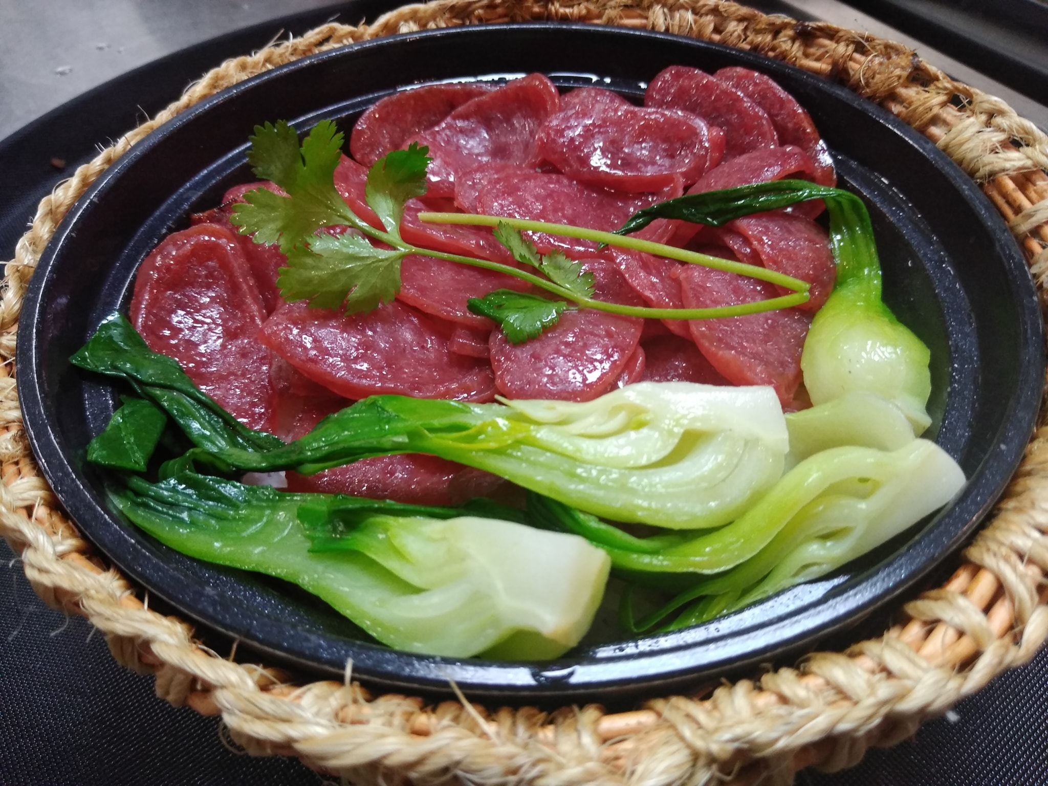 Chinese sausage and bok choy in a soup