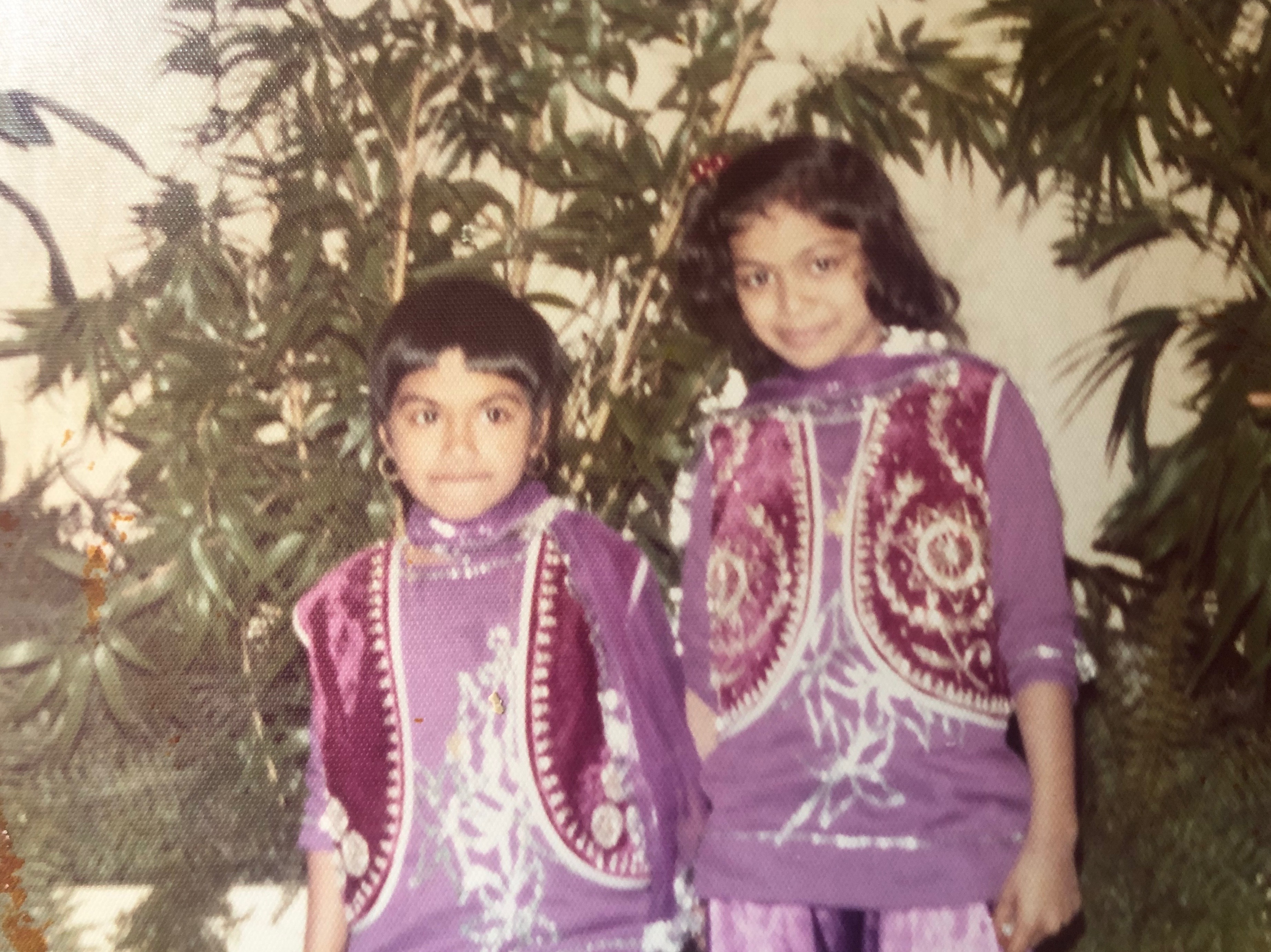The author (after trying cut her own bangs) and her older sister, Samina Hussain, at an Eid celebration at McCormick Place in the 1970s.
