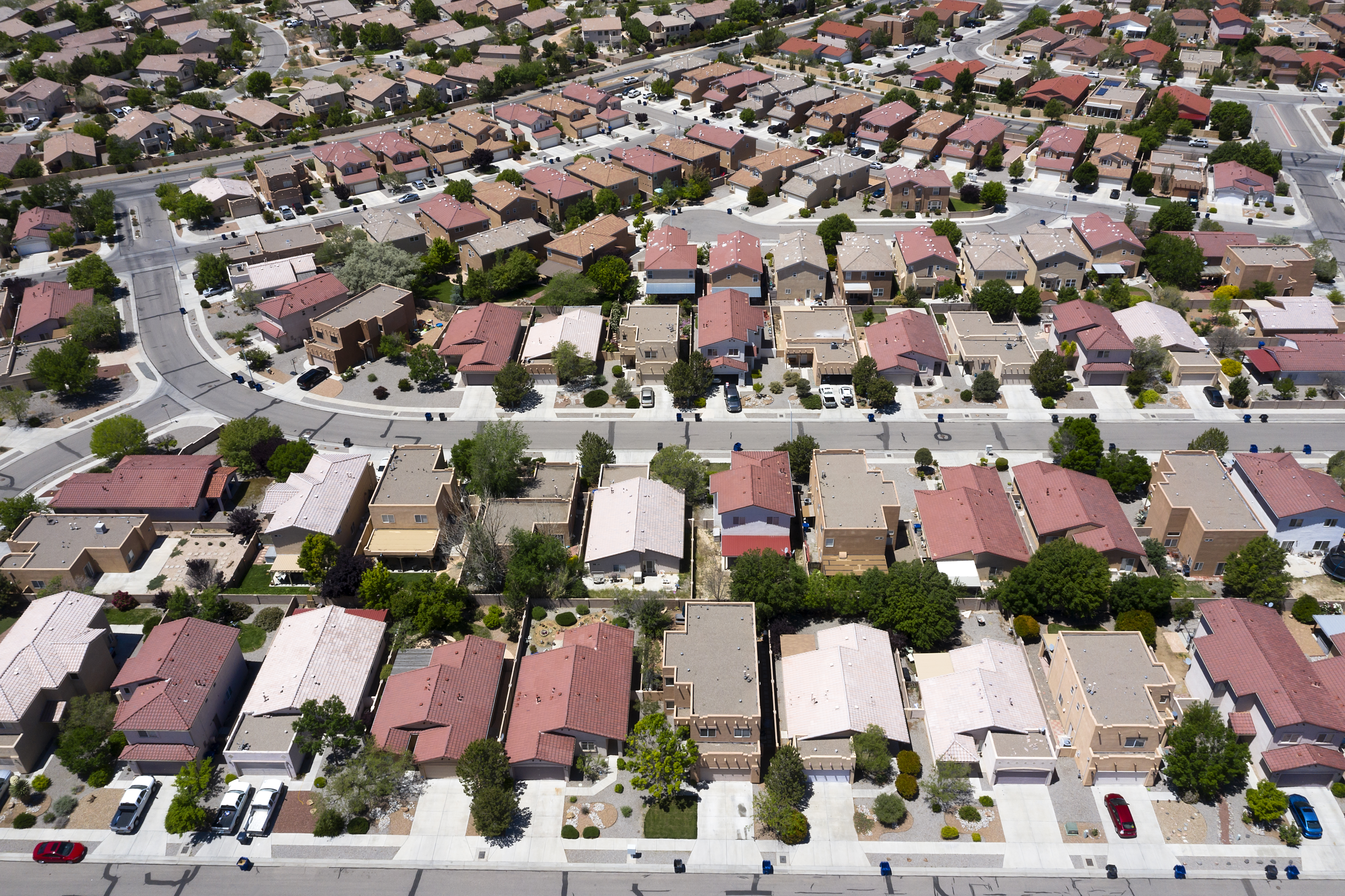 An arial view of a suburban subdivision, filled with single-family houses.