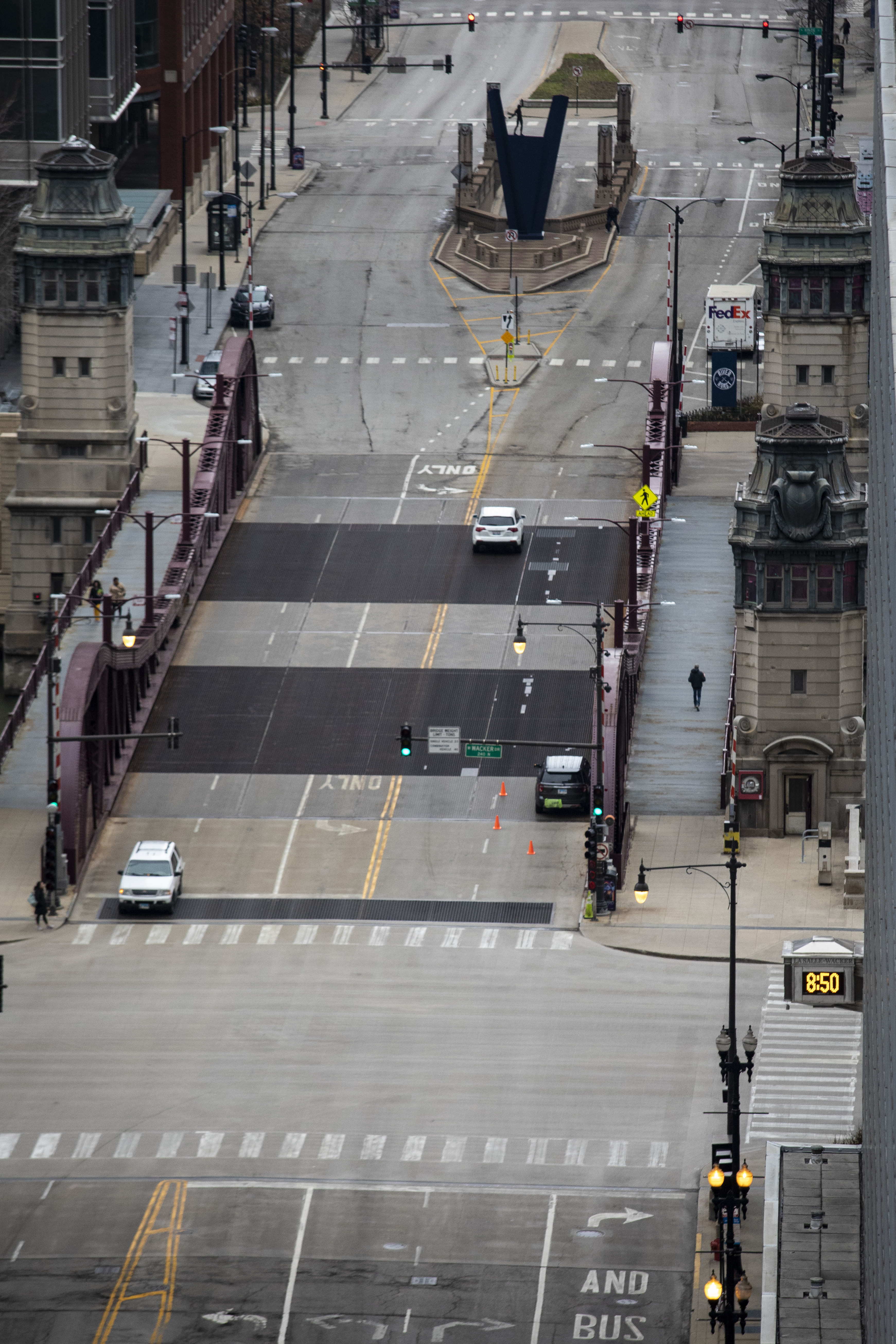 LaSalle Street, nearly empty, at the Chicago River earlier this month. The governor on Thursday extended his stay-at-home order through May.