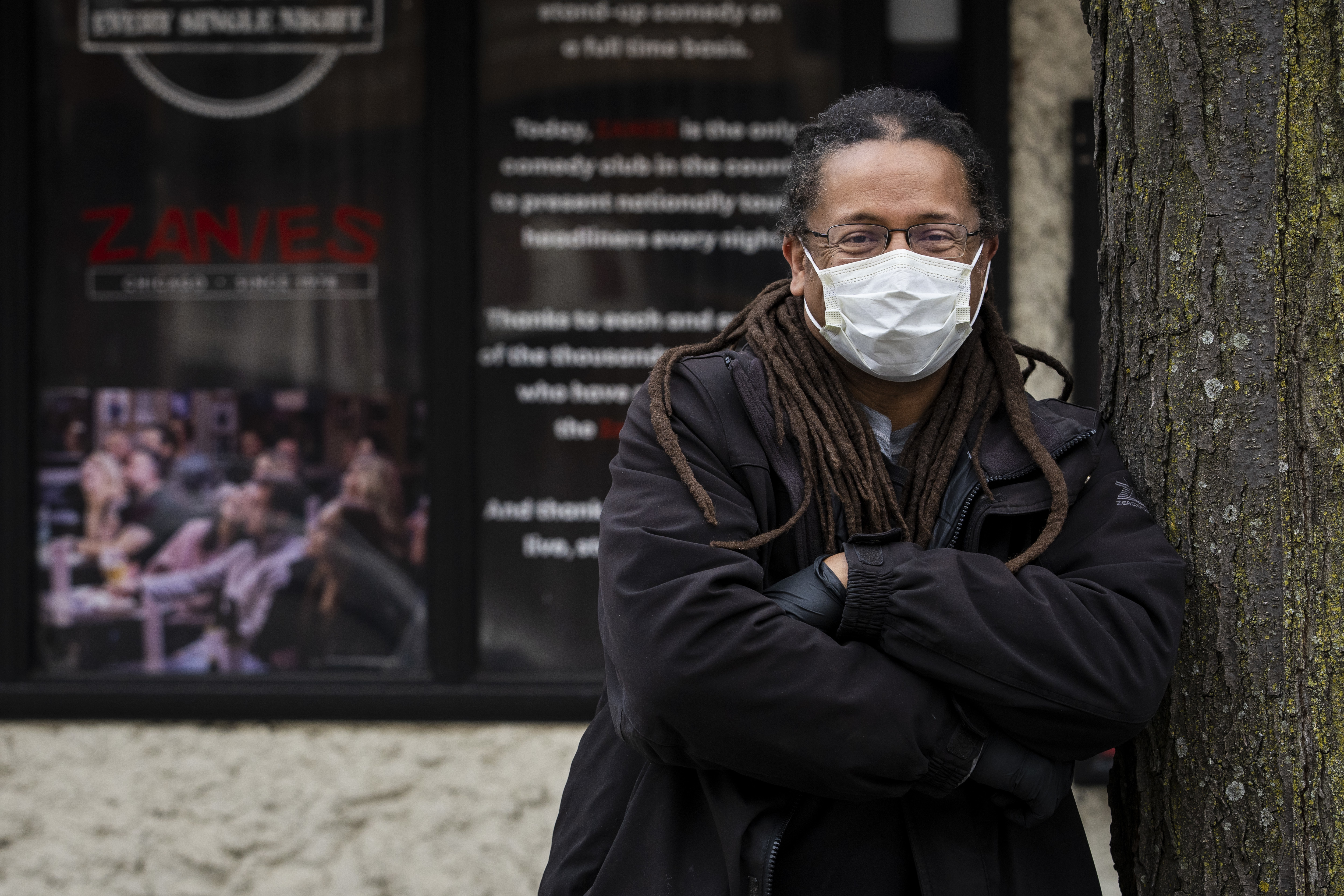 Chicago comedian Dwayne Kennedy is smiling — no, really — behind that mask outside Zanies comedy club in Old Town.