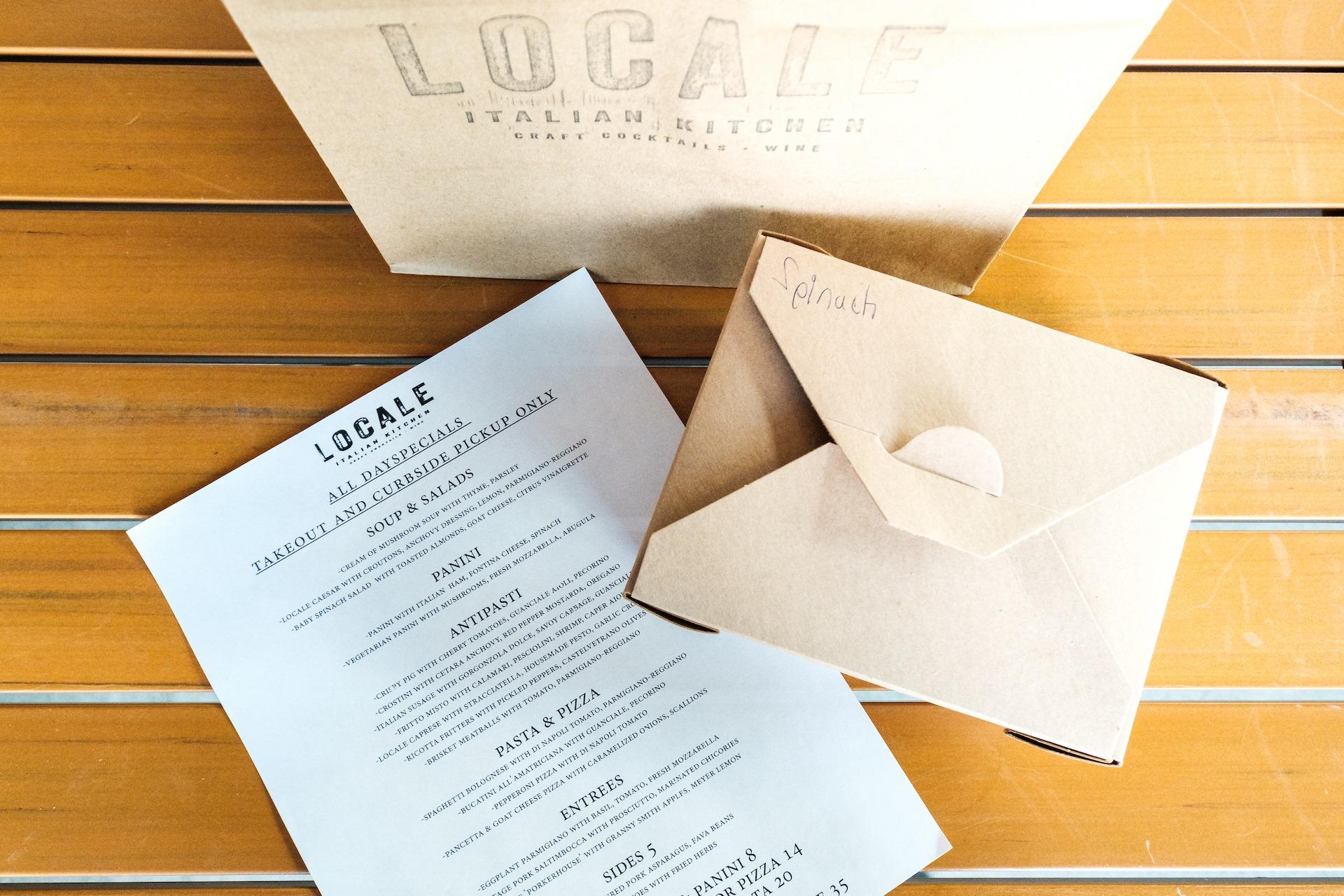 A bag, menu, and takeout box
