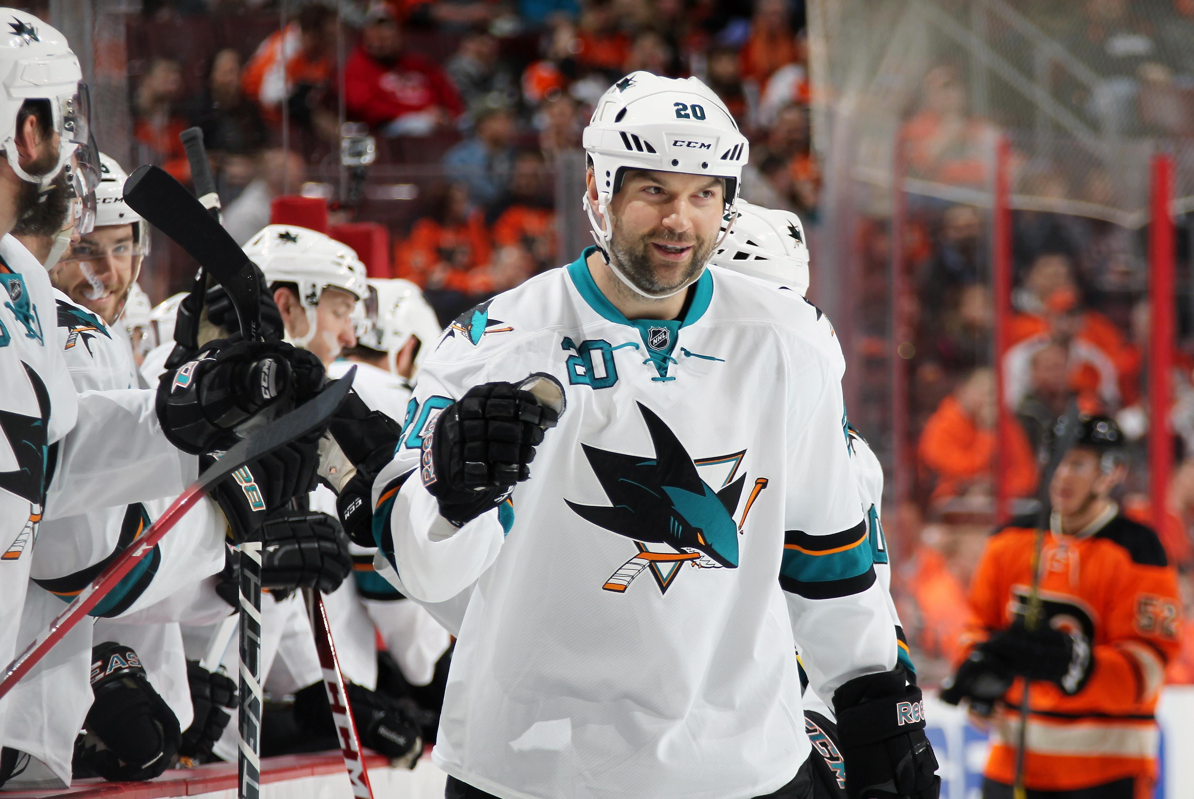 PHILADELPHIA, PA - MARCH 28: John Scott #20 of the San Jose Sharks celebrates a first period goal with teammates against the Philadelphia Flyers on March 28, 2015 at the Wells Fargo Center in Philadelphia, Pennsylvania.