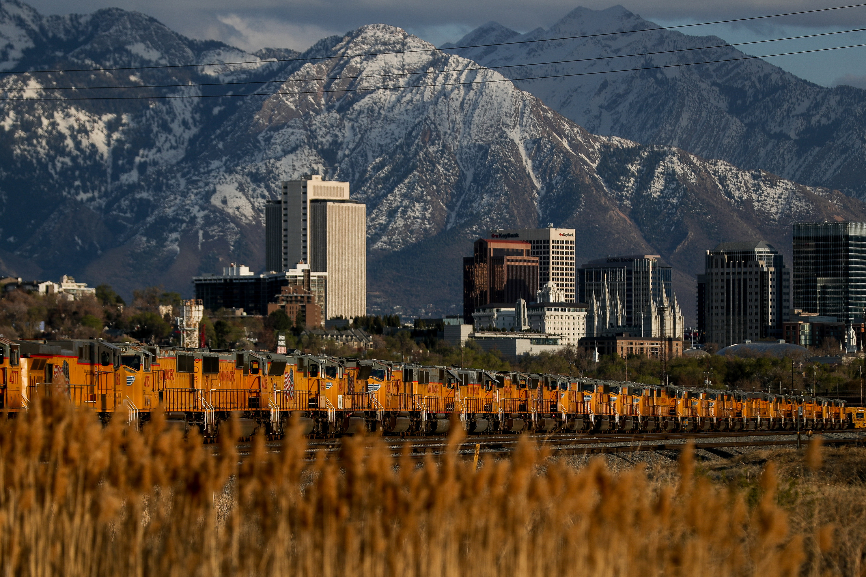 Union Pacific locomotives sit idle in a rail yard north of downtown Salt Lake City on Tuesday, April 7, 2020.