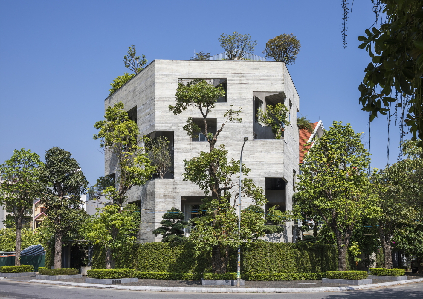 House featuring trees growing out of balconies.