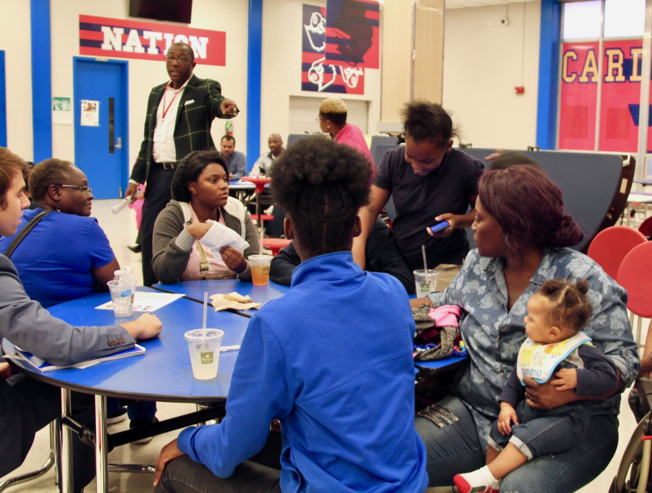 Families weigh in during a conversation on school turnaround at Wooddale High School. It was one of several stops state officials made during a listening tour on the future of improving the state's lowest-performing schools.
