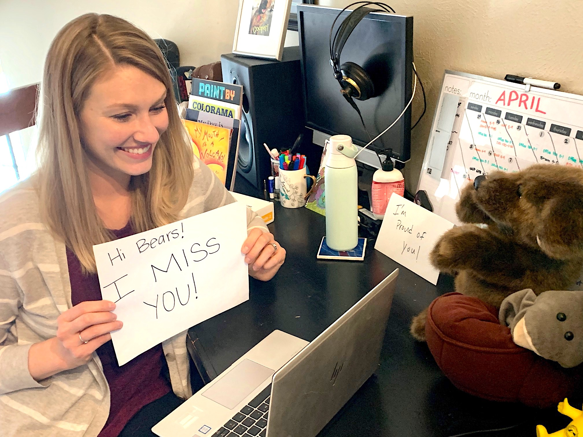Brittany Greiert, a school psychologist at Boston P-8 School in Aurora, references the school's mascot in greeting students during remote learning.