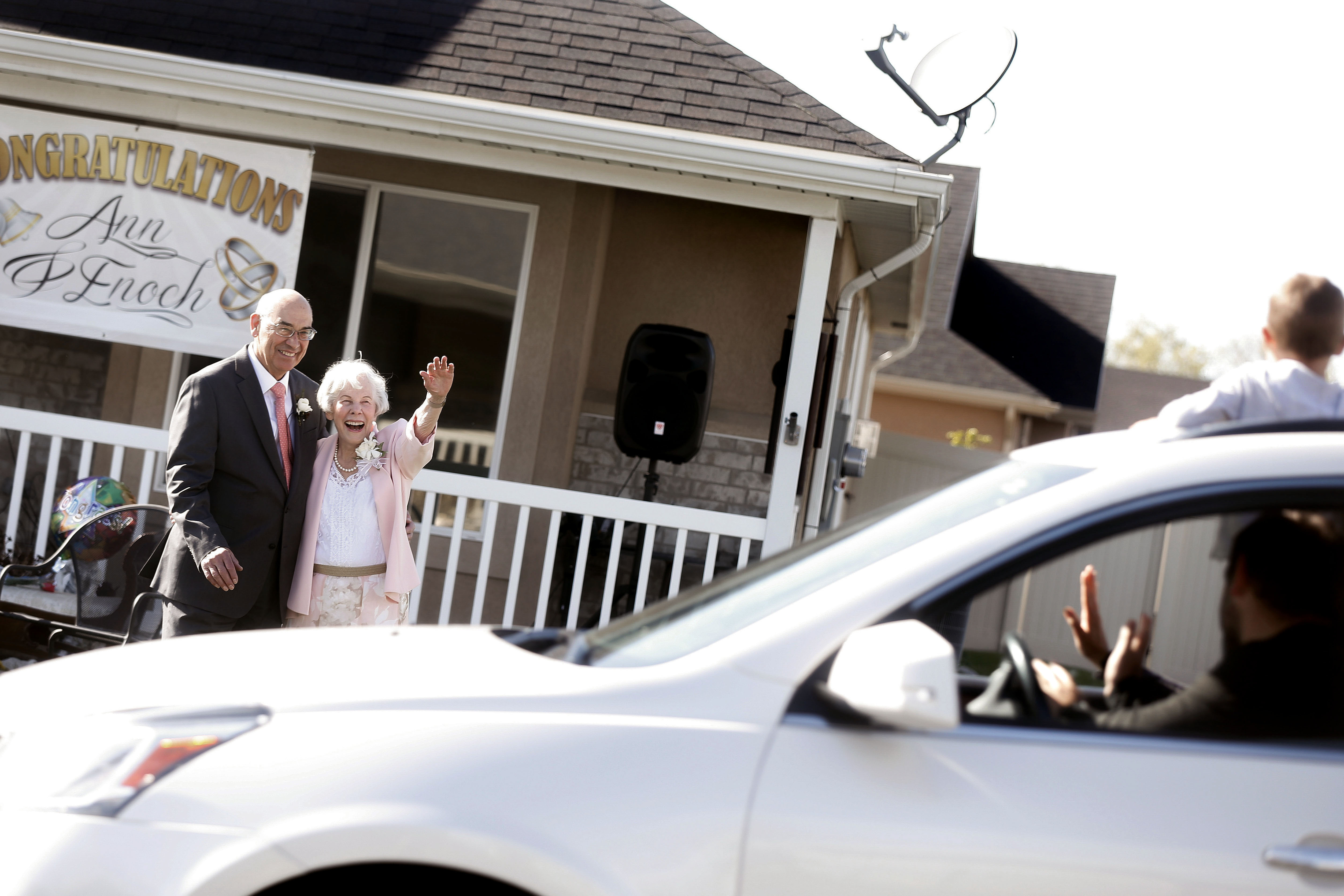 Enoch and Ann Bell wave to their children and grandchildren after their wedding ceremony in Kaysville on Friday, April 24, 2020.