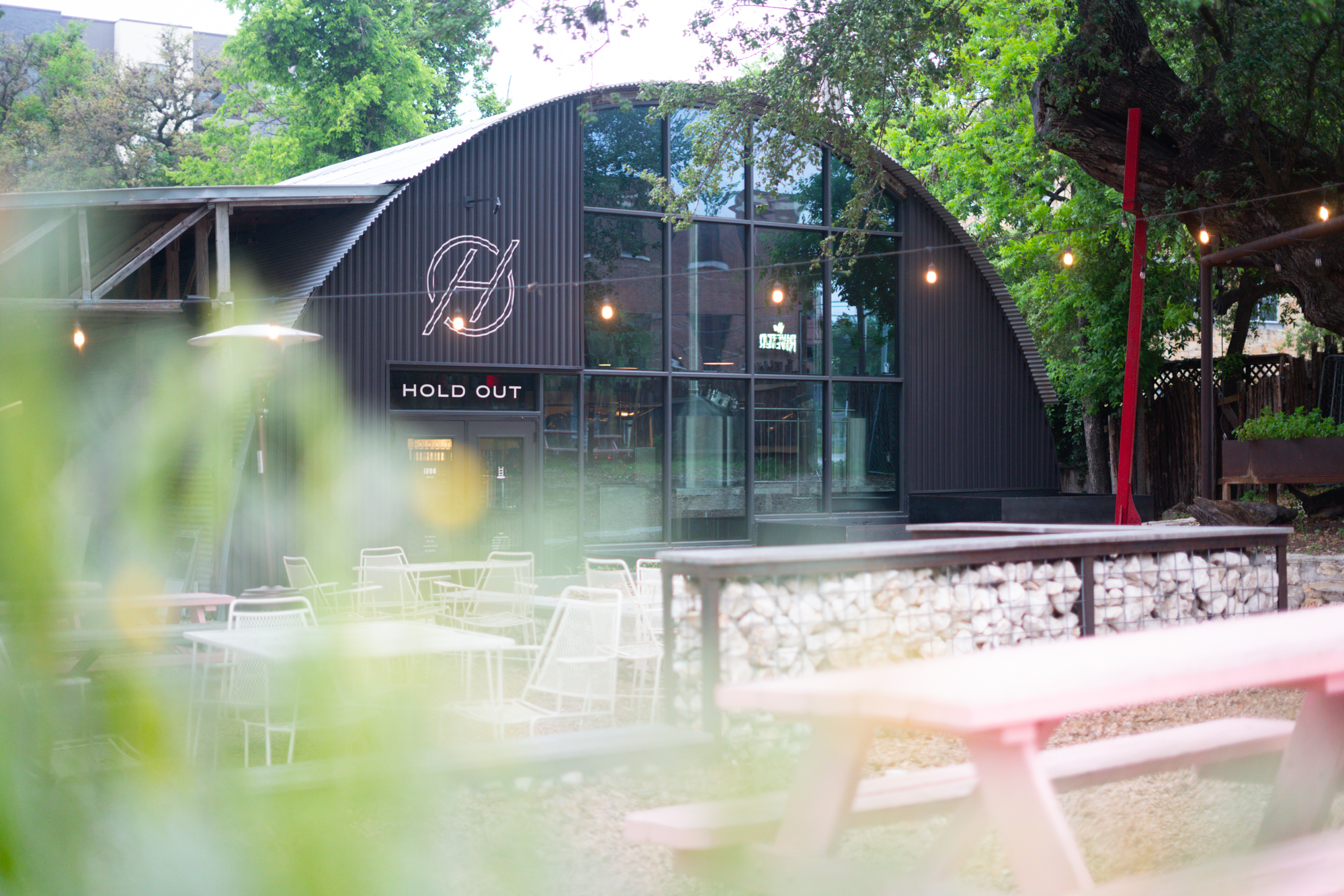 A view of Hold Out Brewing through the courtyard