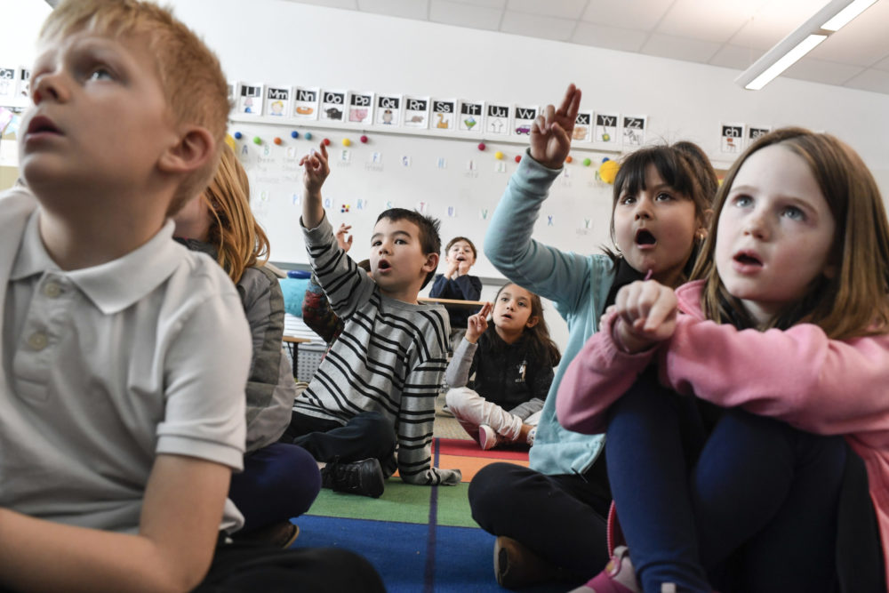 From left, Andrew Kinder, Vyncent Takushi, Sophia Acosta, Kimberley Villalobos-Gurrola, and Katherine Schneider participate in a phonics lesson in Katie Ridder's first grade class at Denver's Willow Elementary on March 4, 2020.