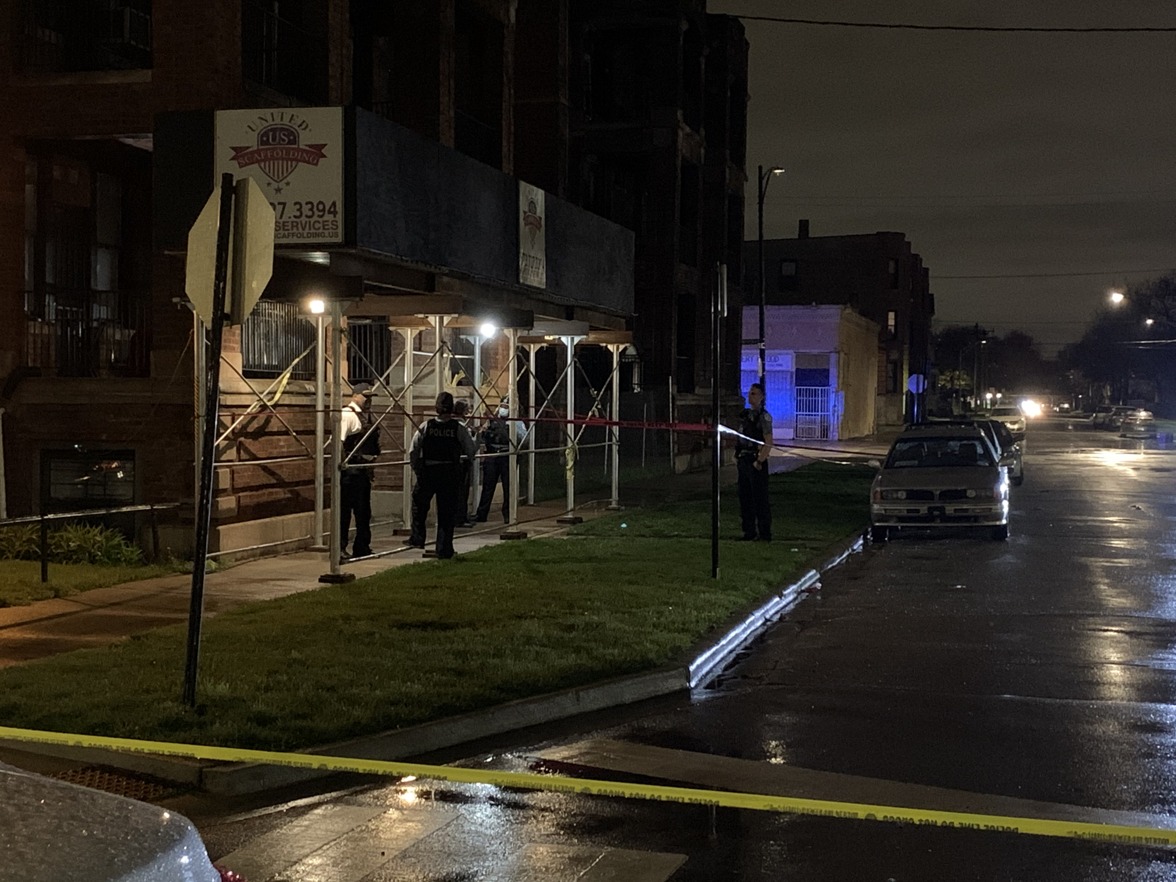 Police investigate the scene where a man was shot to death April 28, 2020 in Park Manor.