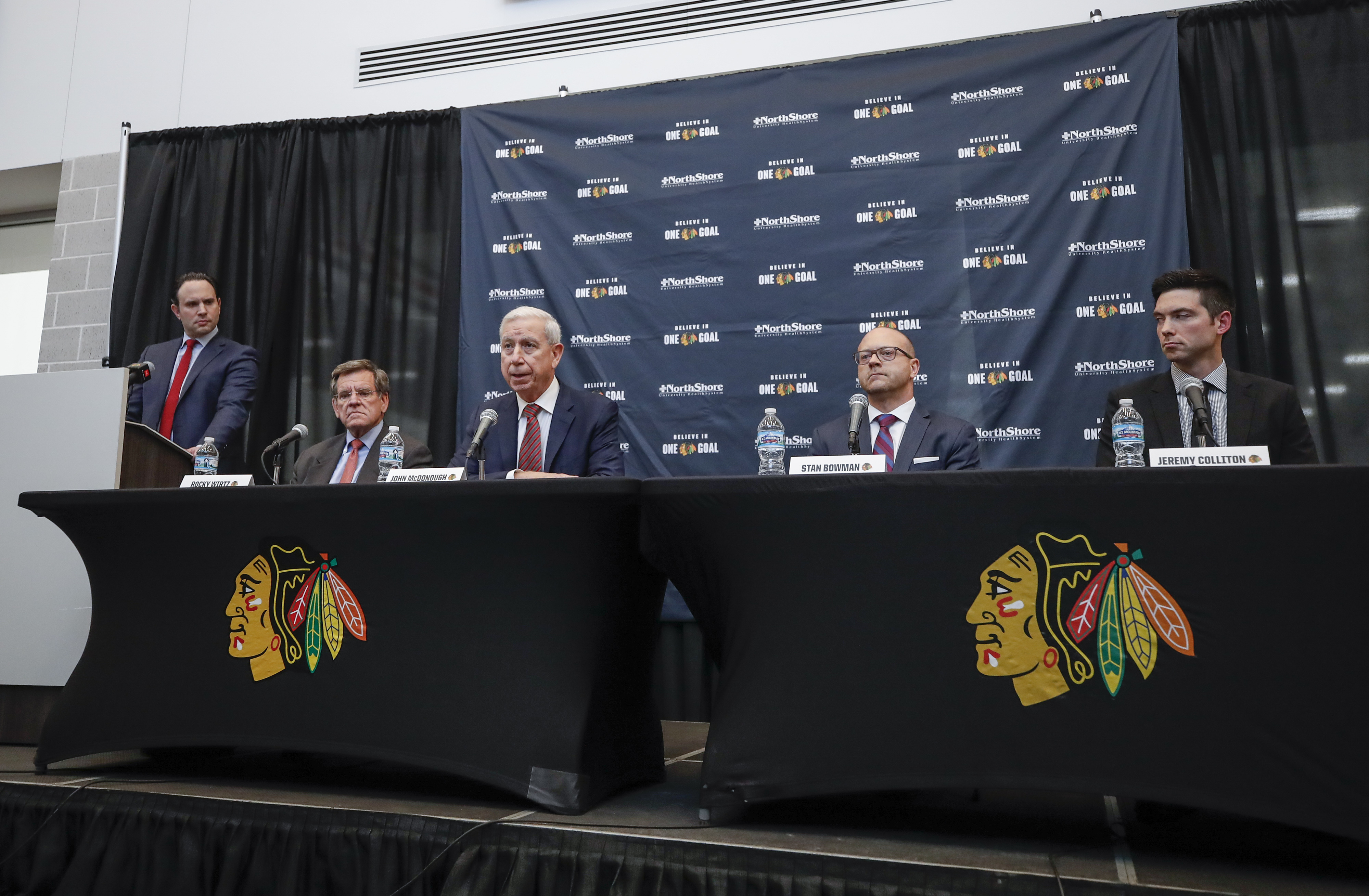 Chairman Rocky Wirtz (second from left), general manager Stan Bowman (second from right) and coach Jeremy Colliton (far right) will now lead the Blackhawks without fired president John McDonough (middle).
