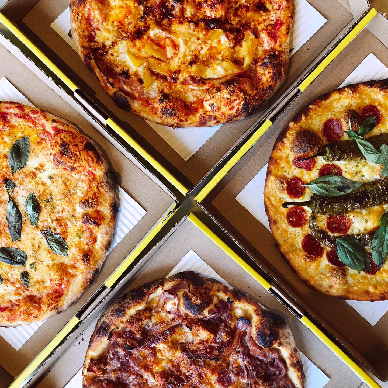 four pizza boxes
