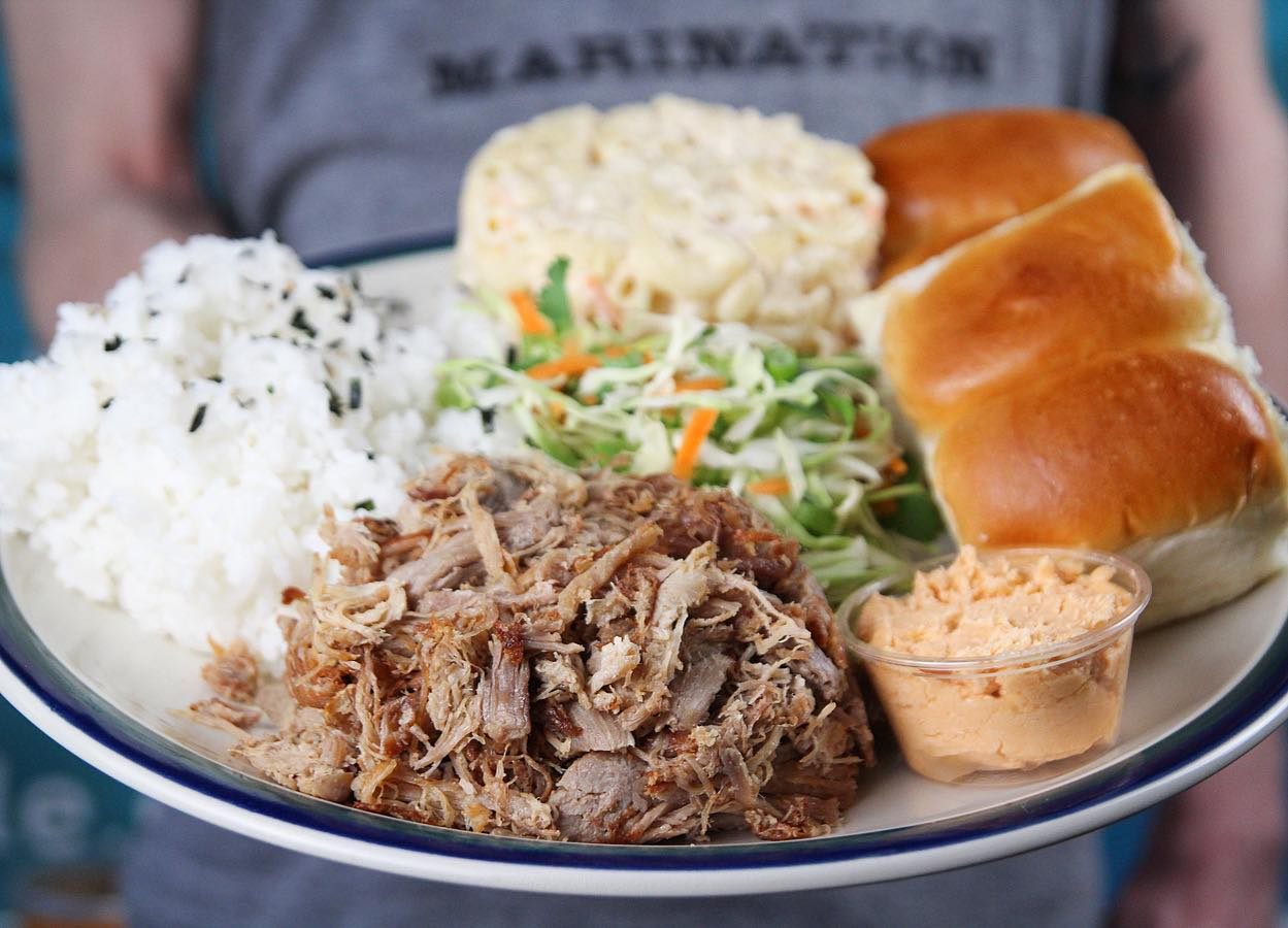 A dish with rice, kalua pork, and Hawaiian rolls from Super Six