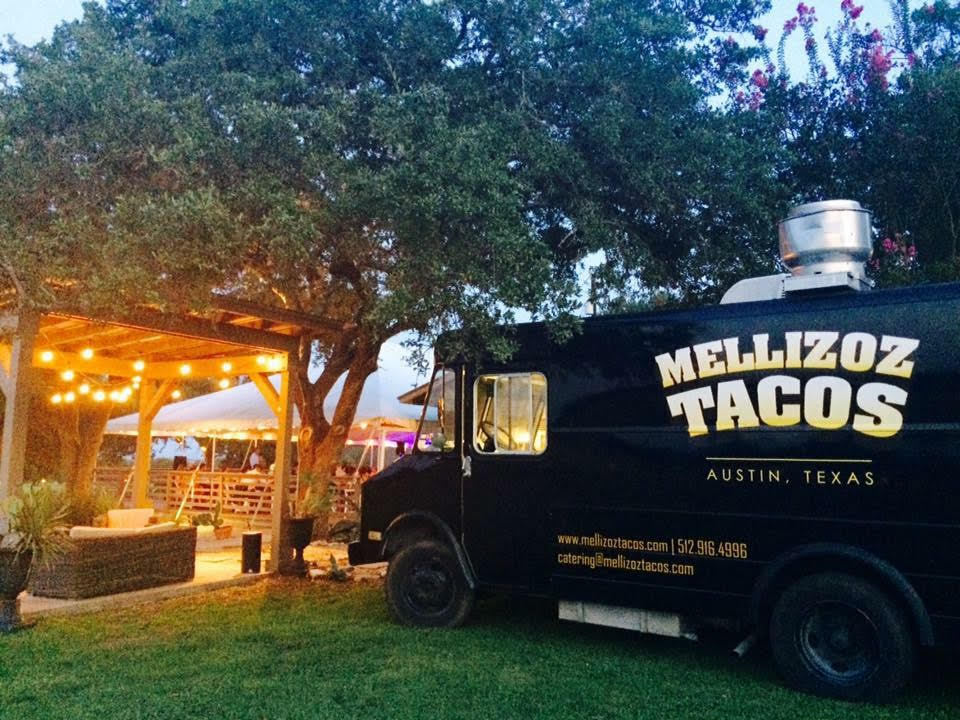 Mellizoz Tacos truck parked at a neighborhood