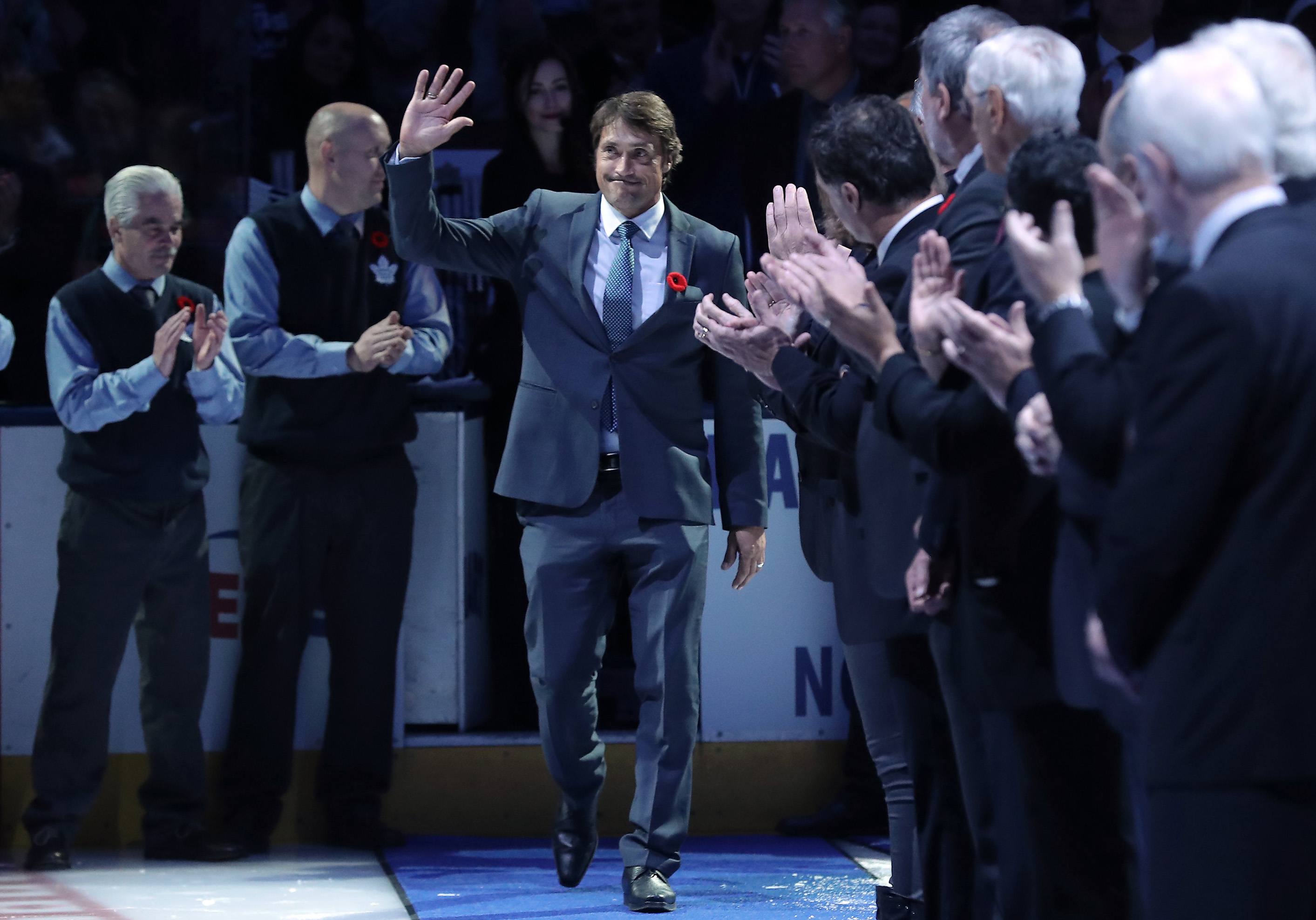 Nov 10, 2017; Toronto, Ontario, CAN; Teemu Selanne acknowledges the applause as he is introduced before his induction into the Hockey Hall of Fame before the Boston Bruins Hockey Hall of Fame Game against the Toronto Maple Leafs at Air Canada Centre. The Maple Leafs beat the Bruins 3-2 in overtime.