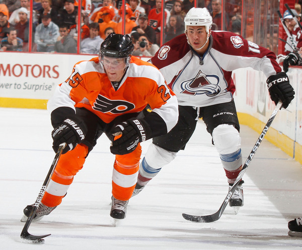 """Newly re-acquired defender Matt Carle is one of several """"new"""" faces with the Tampa Bay Lightning this season."""