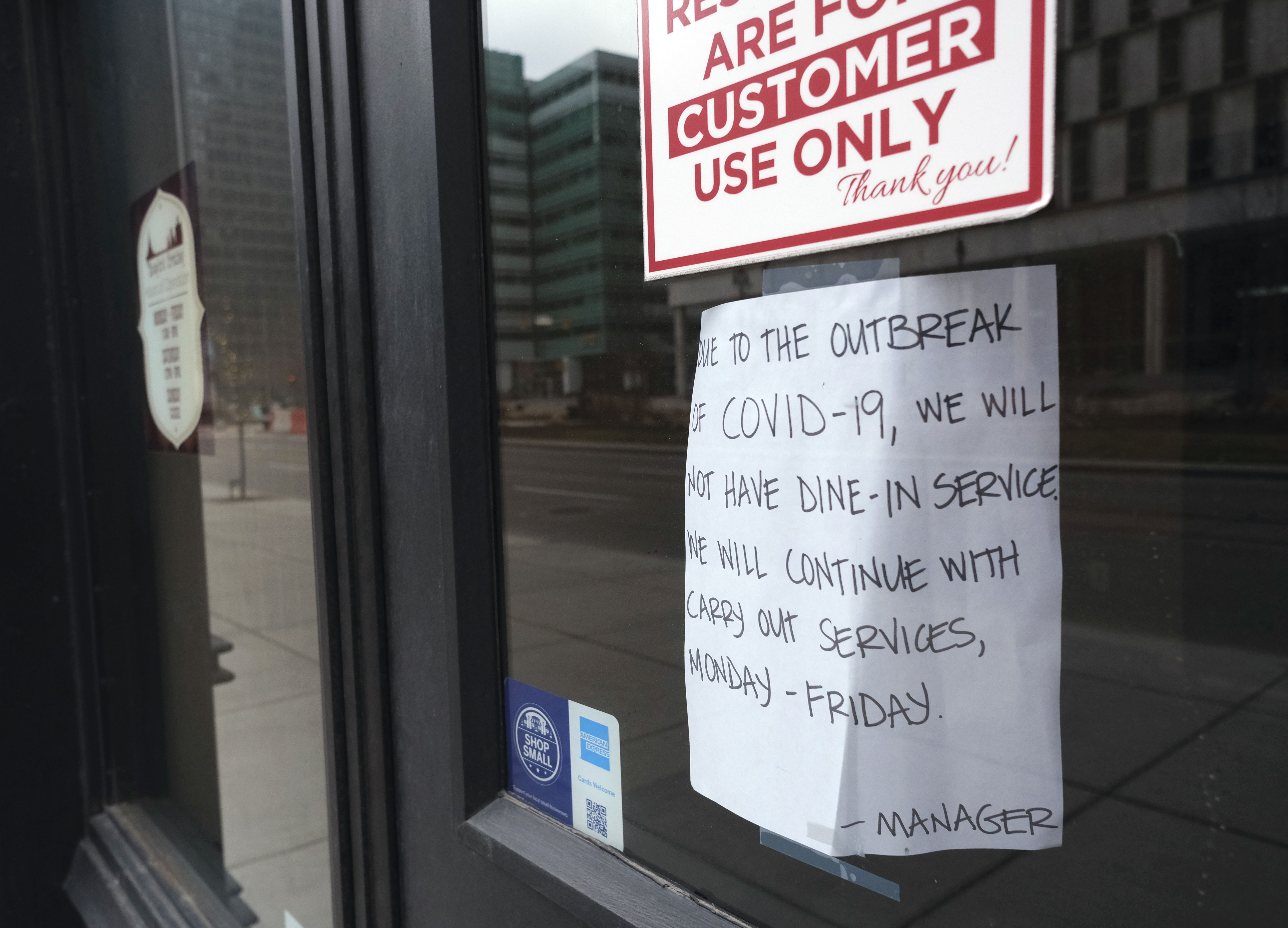 A sign explains the closure of a Detroit, Michigan restaurant due to Coronavirus (COVID-19) on March 24, 2020. - At 12:01 am Tuesday March 24,2020 Governor Gretchen Whitmer ordered a 'Stay at Home and Stay Safe Order' to slow the spread of Coronavirus (COVID-19) across the State of Michigan which now has 1,791 confirmed cases and 24 deaths due to the virus. (Photo by SETH HERALD / AFP)
