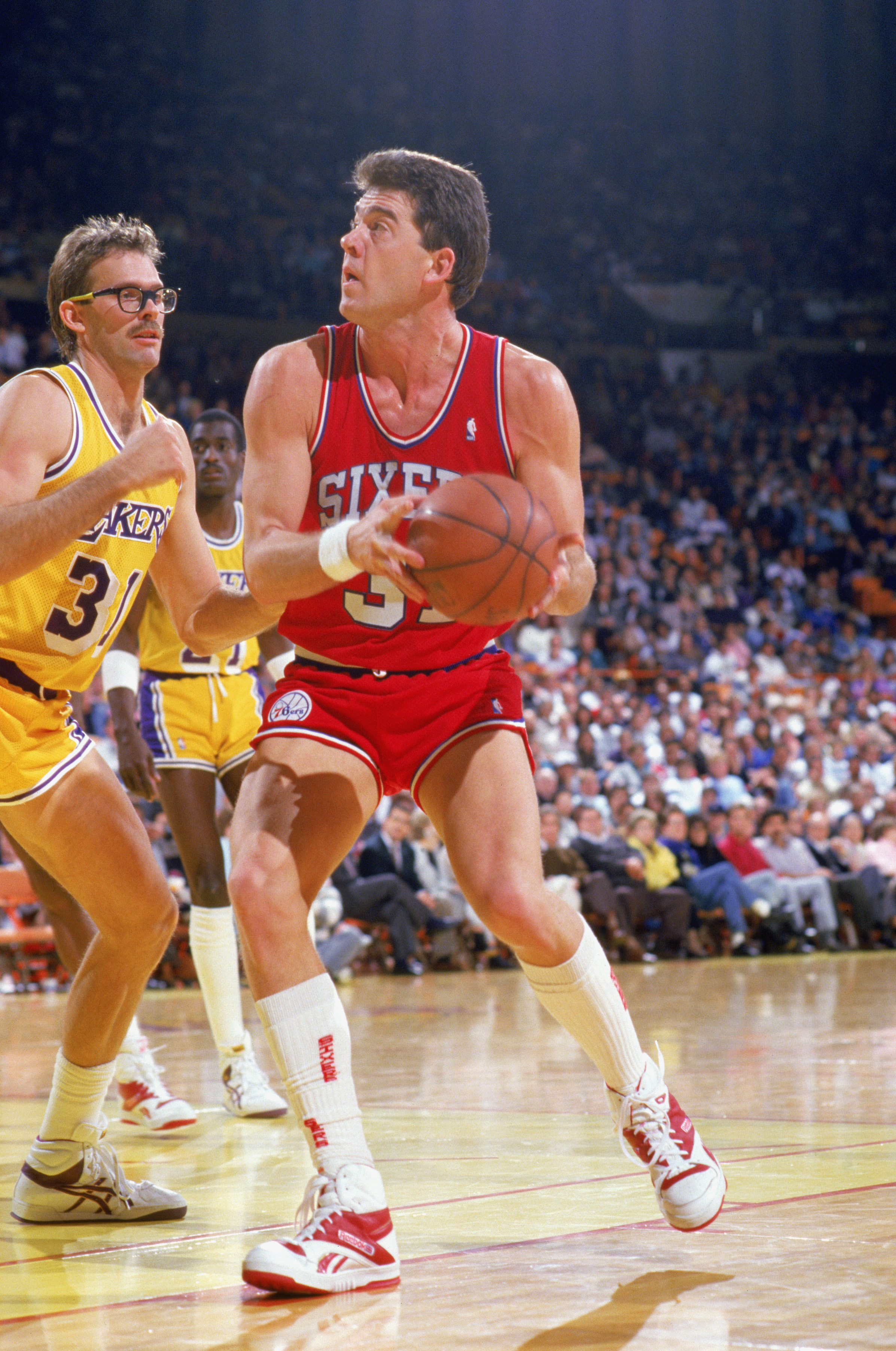 Mark McNamara goes to the basket