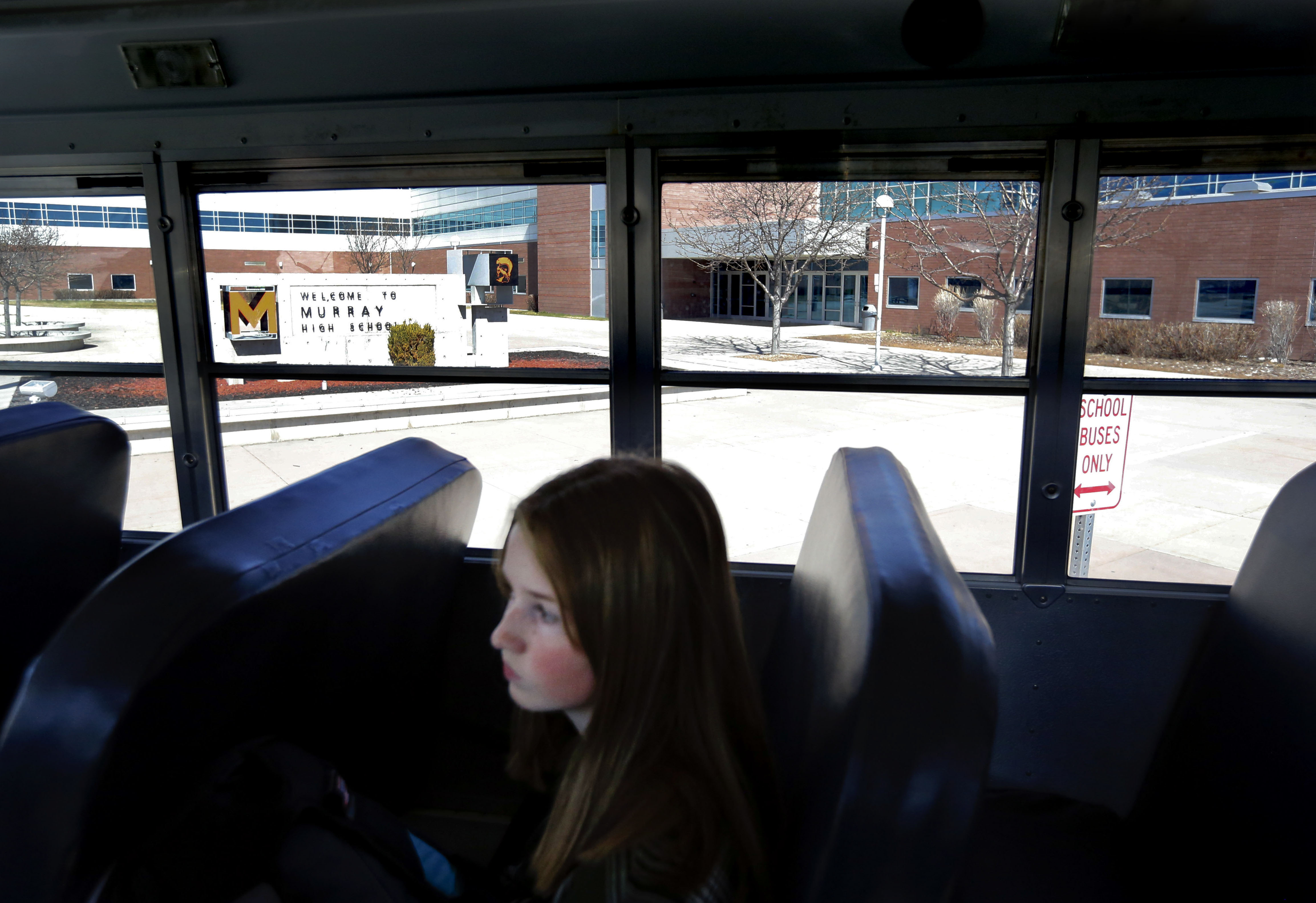 Sophomore Zoe Scott waits for her bus to leave Murray High School on Thursday, March 12, 2020. Murray City School District announced Thursday it is closing its schools until further notice amid spread of the novel coronavirus in Utah. Most students and teachers left school after the announcement was made earlier in the day.