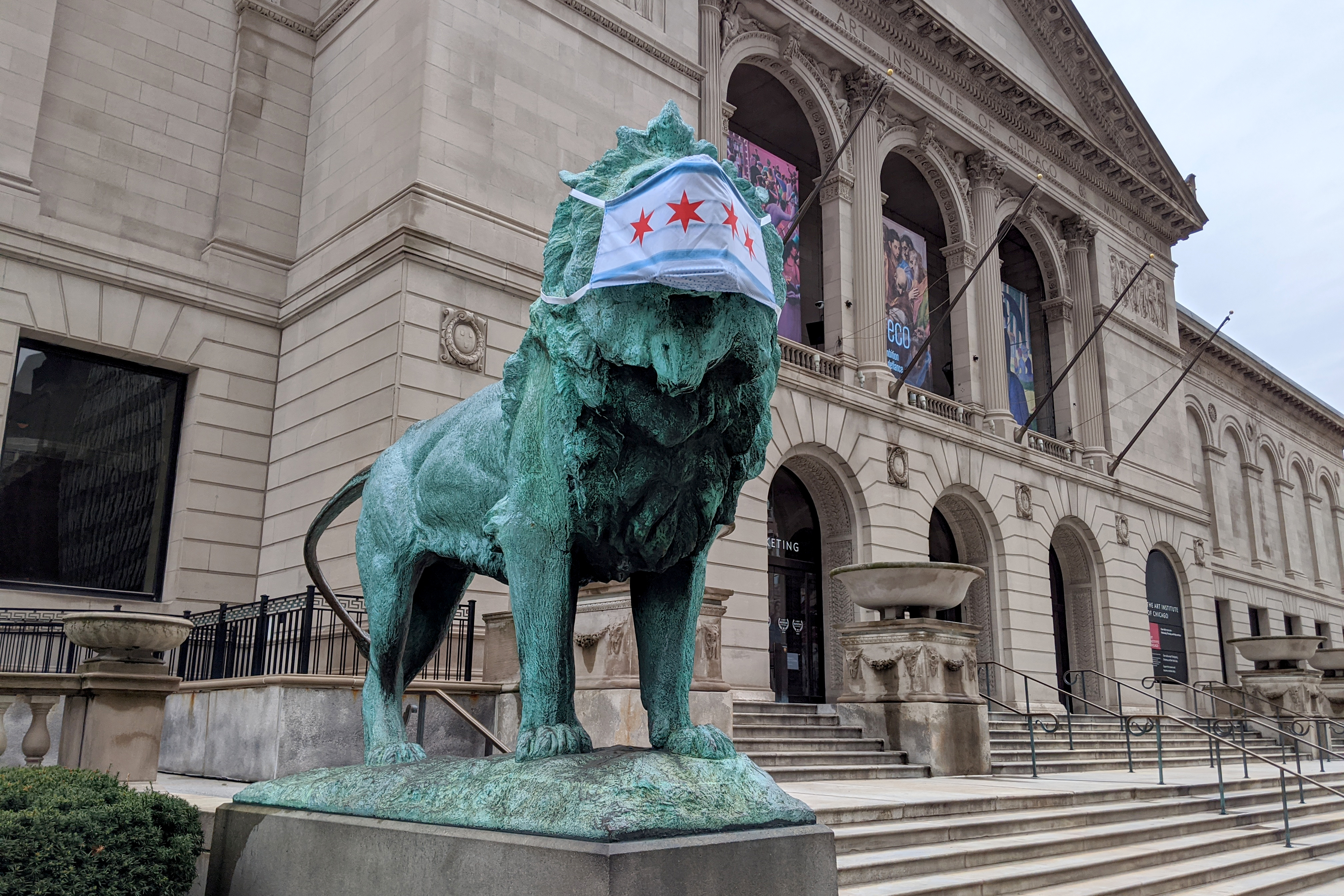 The lions wear face masks outside the The Art Institute of Chicago during the coronavirus pandemic, Thursday afternoon, April 30, 2020.