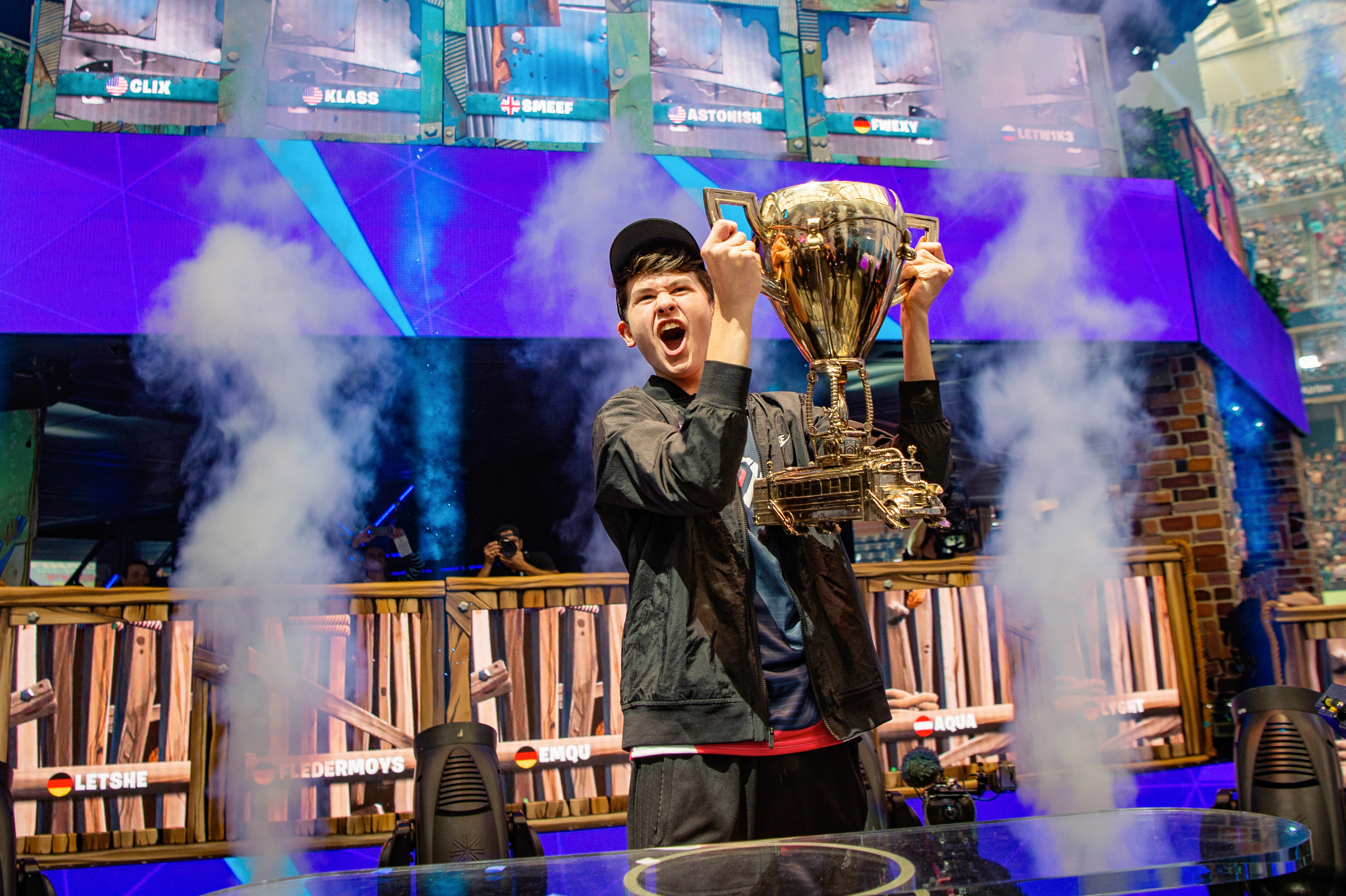"""Kyle """"Bugha"""" Giersdorf lifts the trophy at the 2019 Fortnite World Cup after winning in solos"""