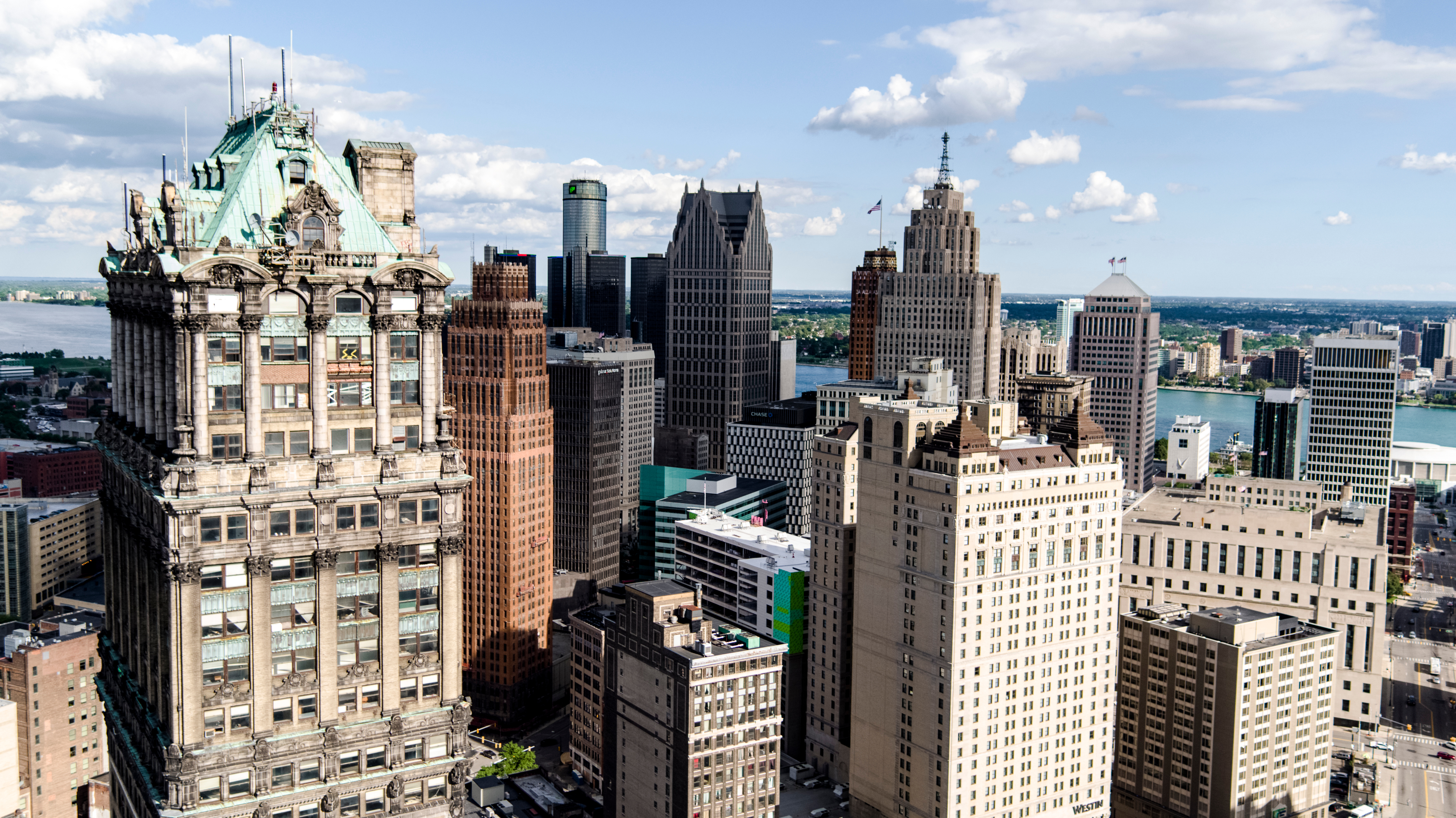 A close crop of downtown Detroit buildings showcases a mix of architectural styles.