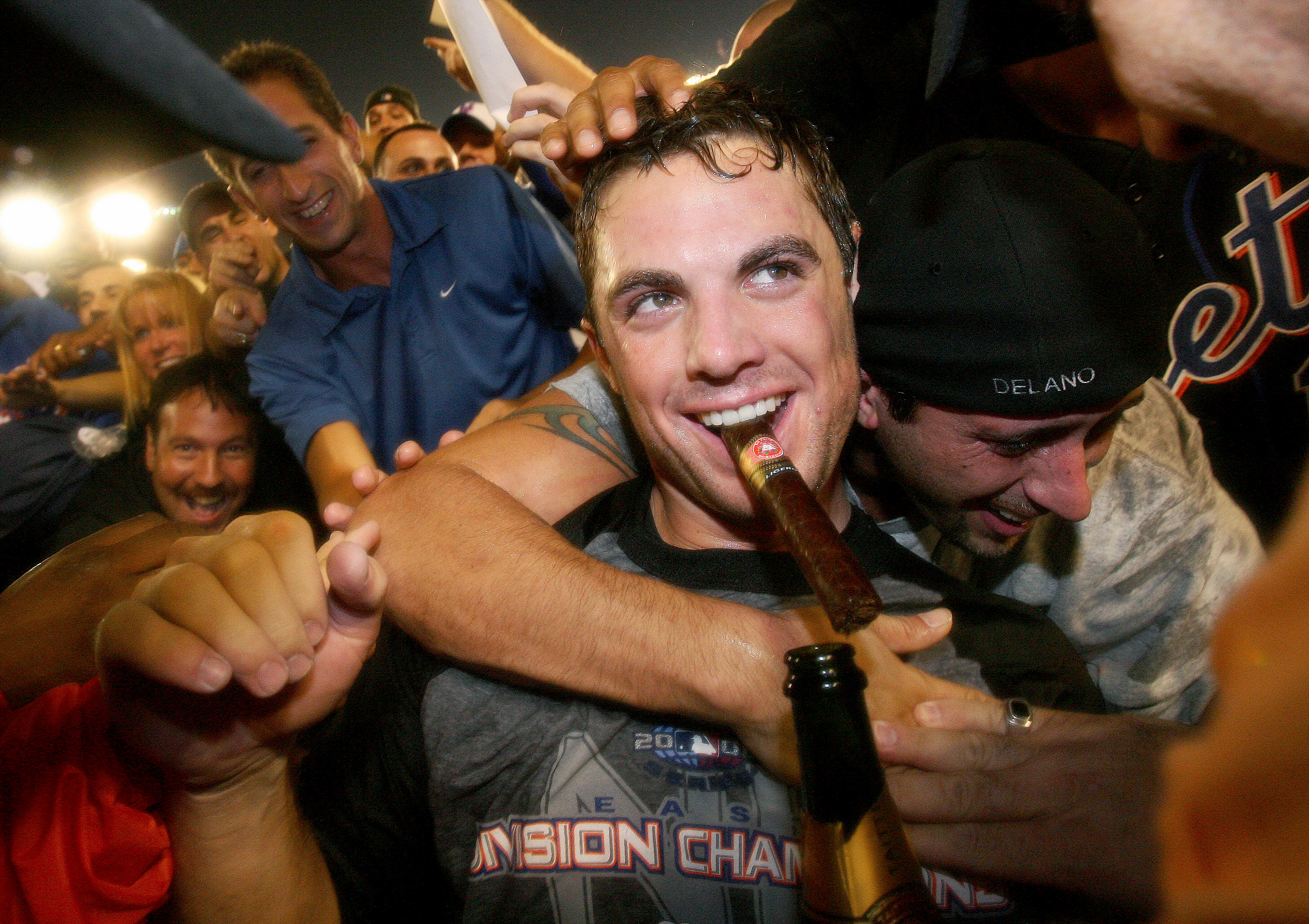 New York Mets' David Wright celebrates with a cigar and spar