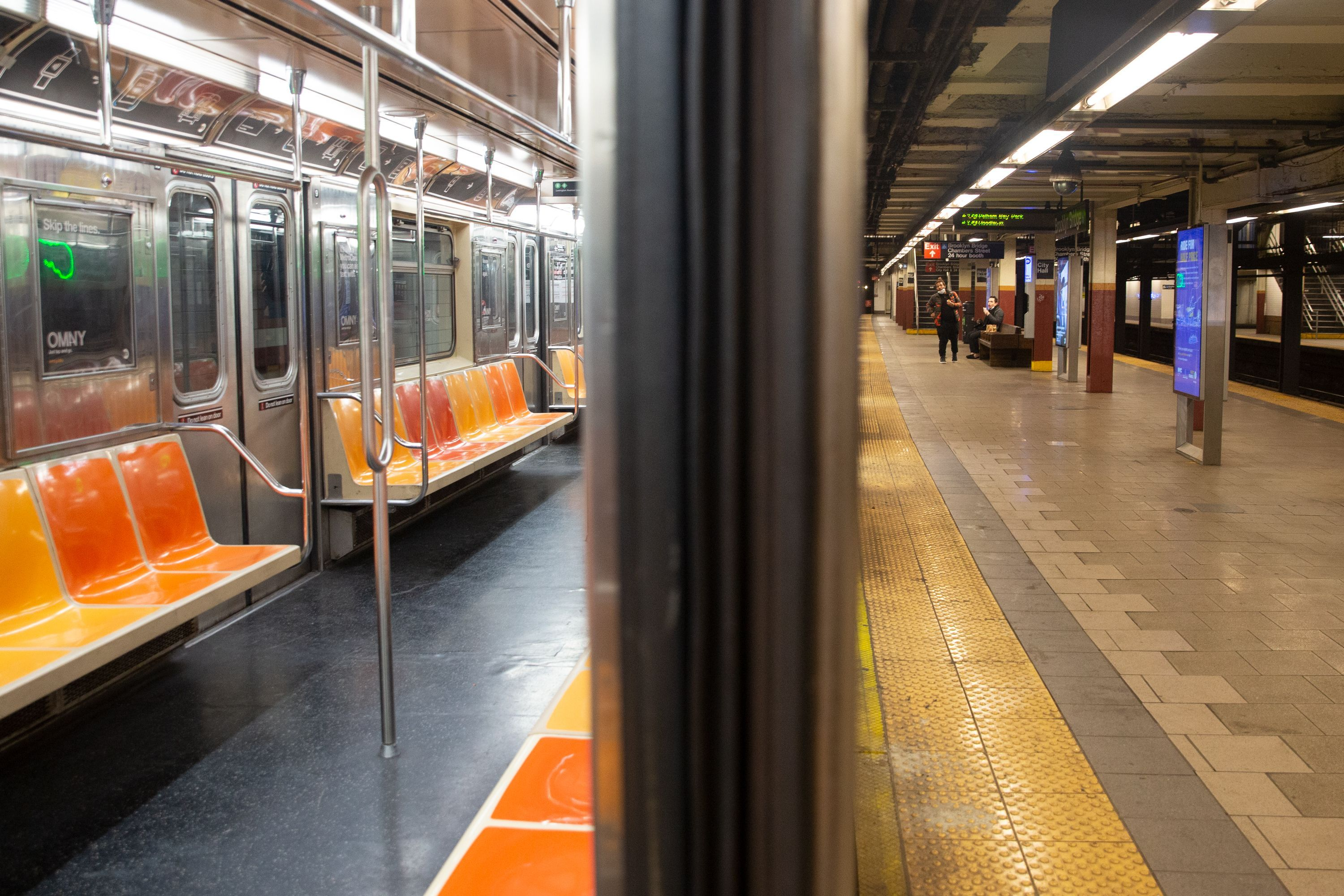 An empty 6 train sits at the City Hall station during the coronavirus epidemic.
