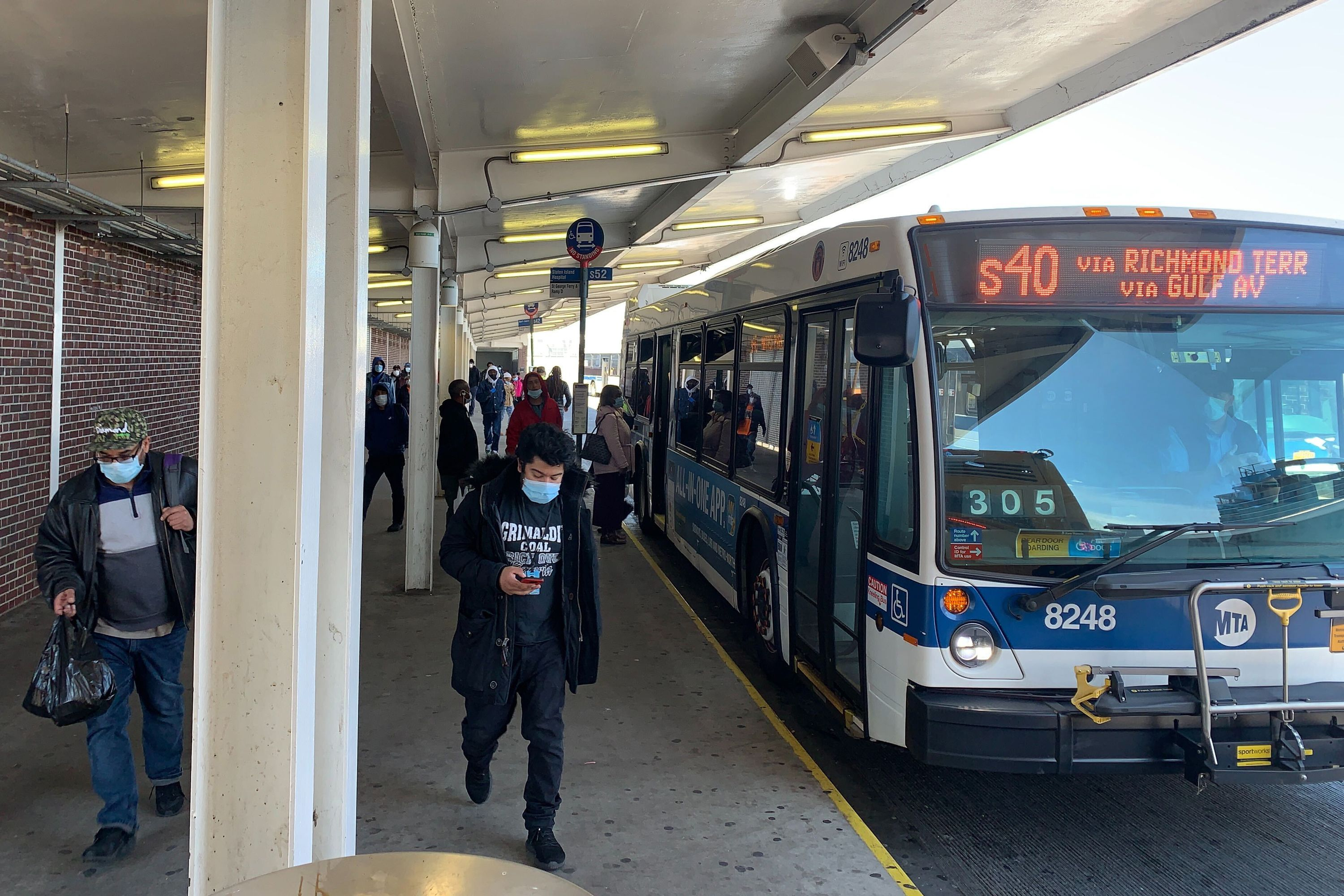 Passengers board an S40 bus at the St. George Ferry Terminal, which Amazon employees use to commute to the company's JFK8 Fulfillment Center.