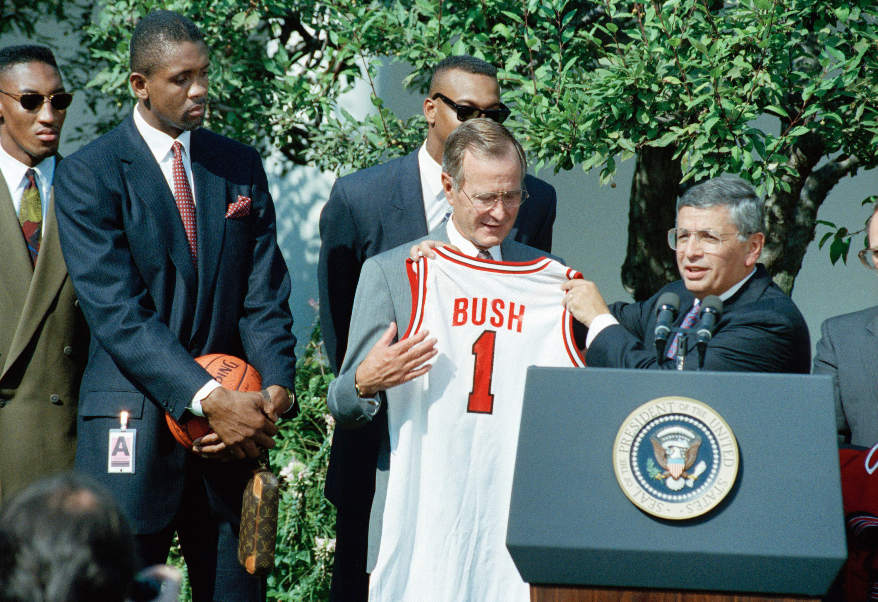 NBA Commissioner David Stern presents President Bush with a Chicago Bulls jersey during a Rose Garden ceremony.