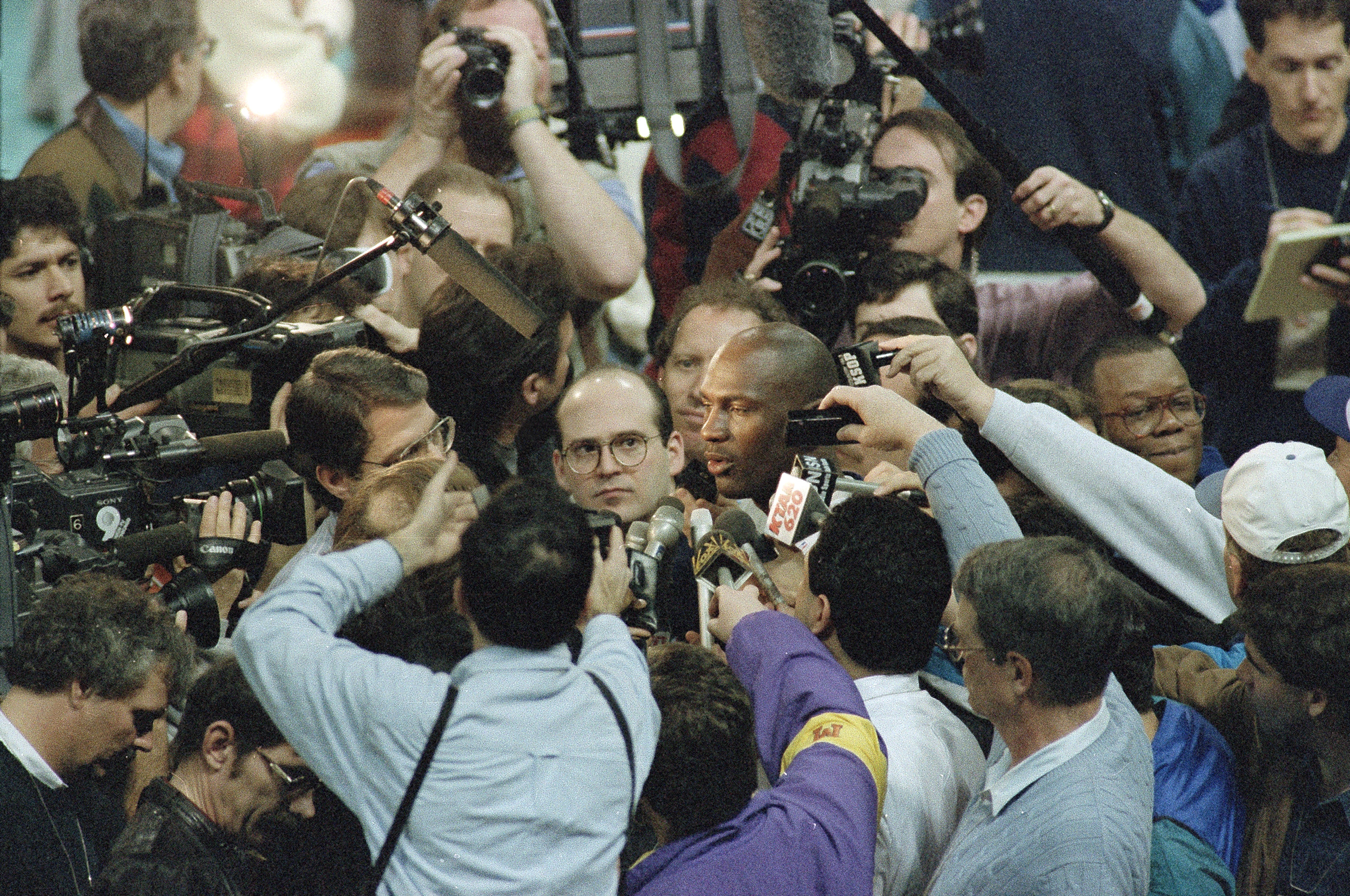 Michael Jordan is mobbed by the media during an All-Star Game session in Salt Lake City in 1993.