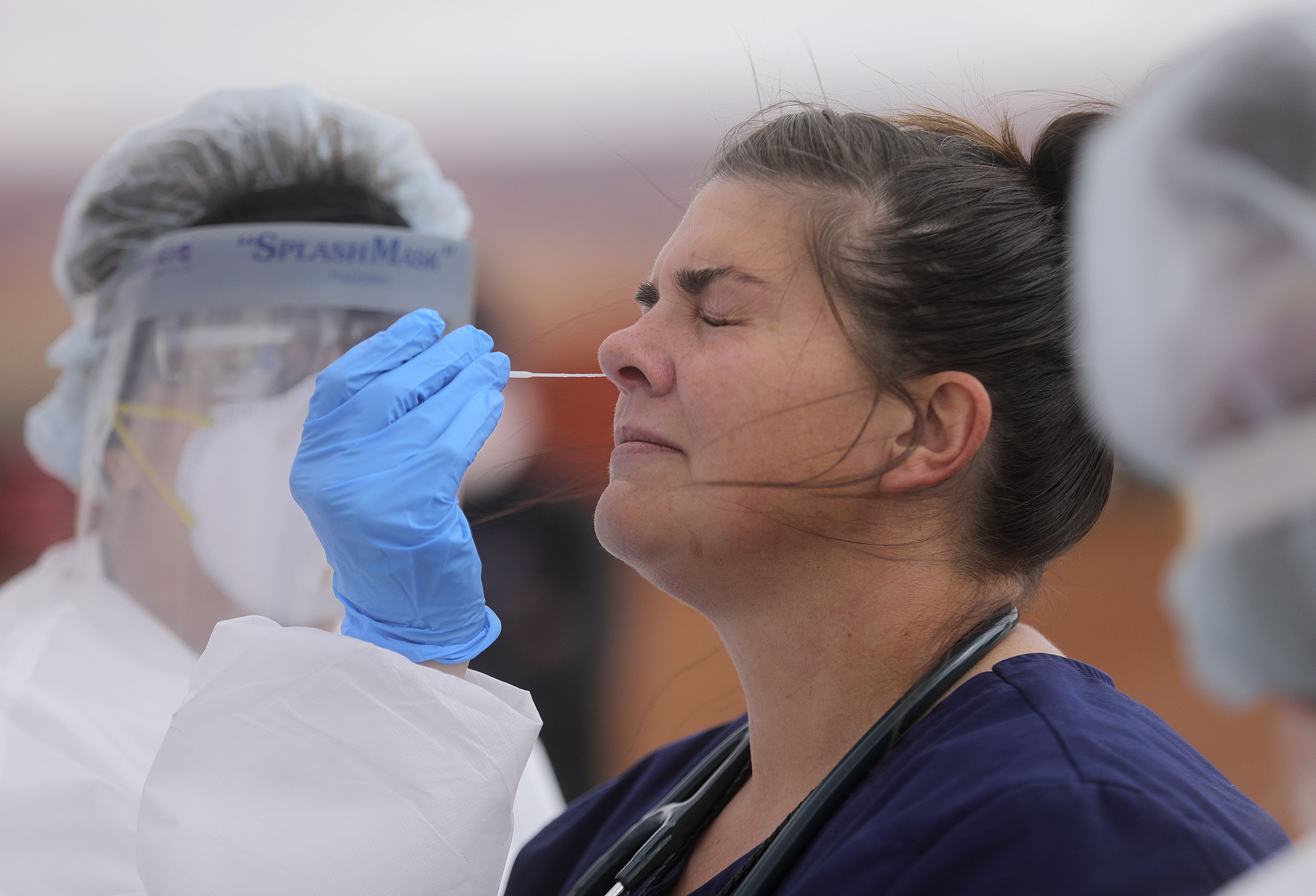 Amber Rasmussen, a physician assistant who has been administering the COVID-19 tests to local patients prior to mobile testing and providing triage at Monument Valley Health Center in Oljato-Monument Valley, San Juan County, gets tested for COVID-19 outside center on Thursday, April 16, 2020.