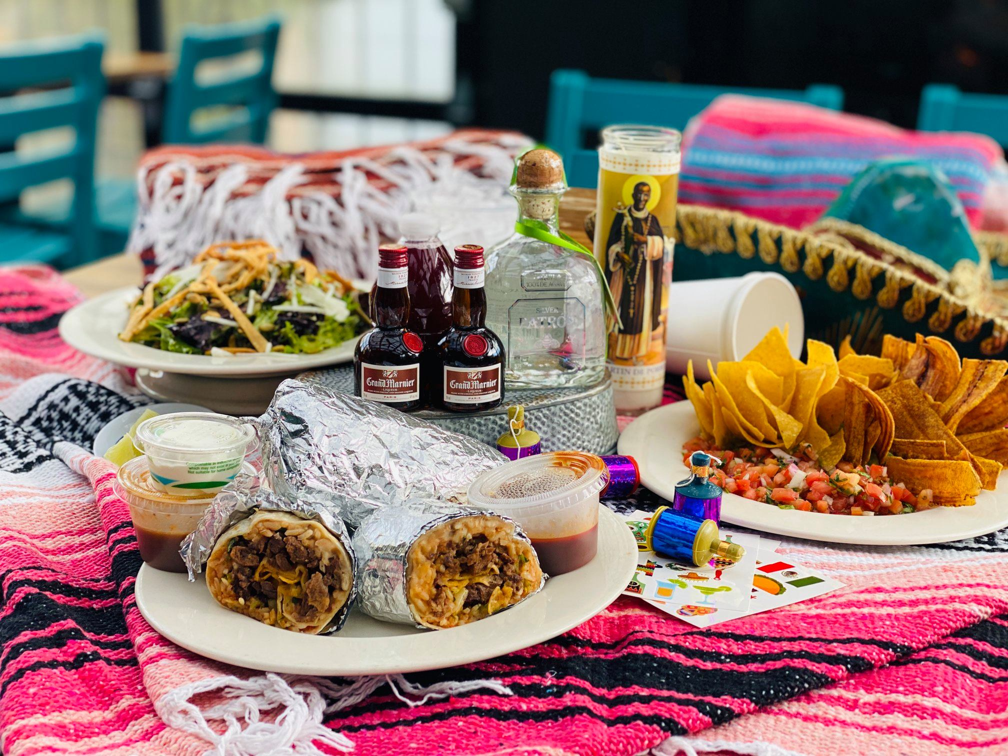 A selection of Mexican food and drinks on a blanket from El Camino