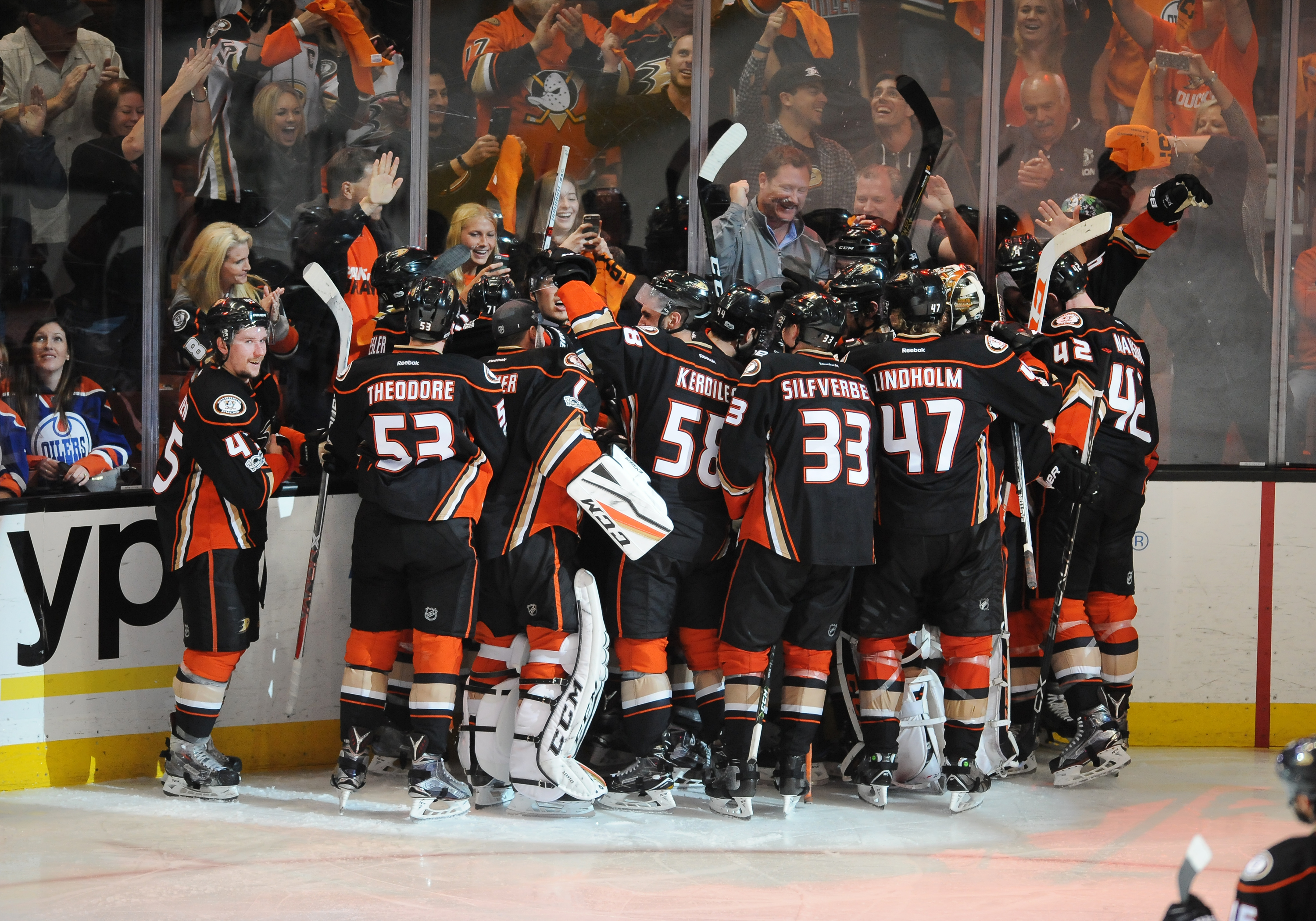 ANAHEIM, CA - MAY 05: Anaheim Ducks rightwing Corey Perry (10) is surrounded by Ducks teammates and fans after Perry scored the game winning goal in the second overtime period to defeat the Edmonton Oilers 4 to 3 in game 5 of the second round of the 2017 Stanley Cup Playoffs played on May 5, 2017 at the Honda Center in Anaheim, CA.