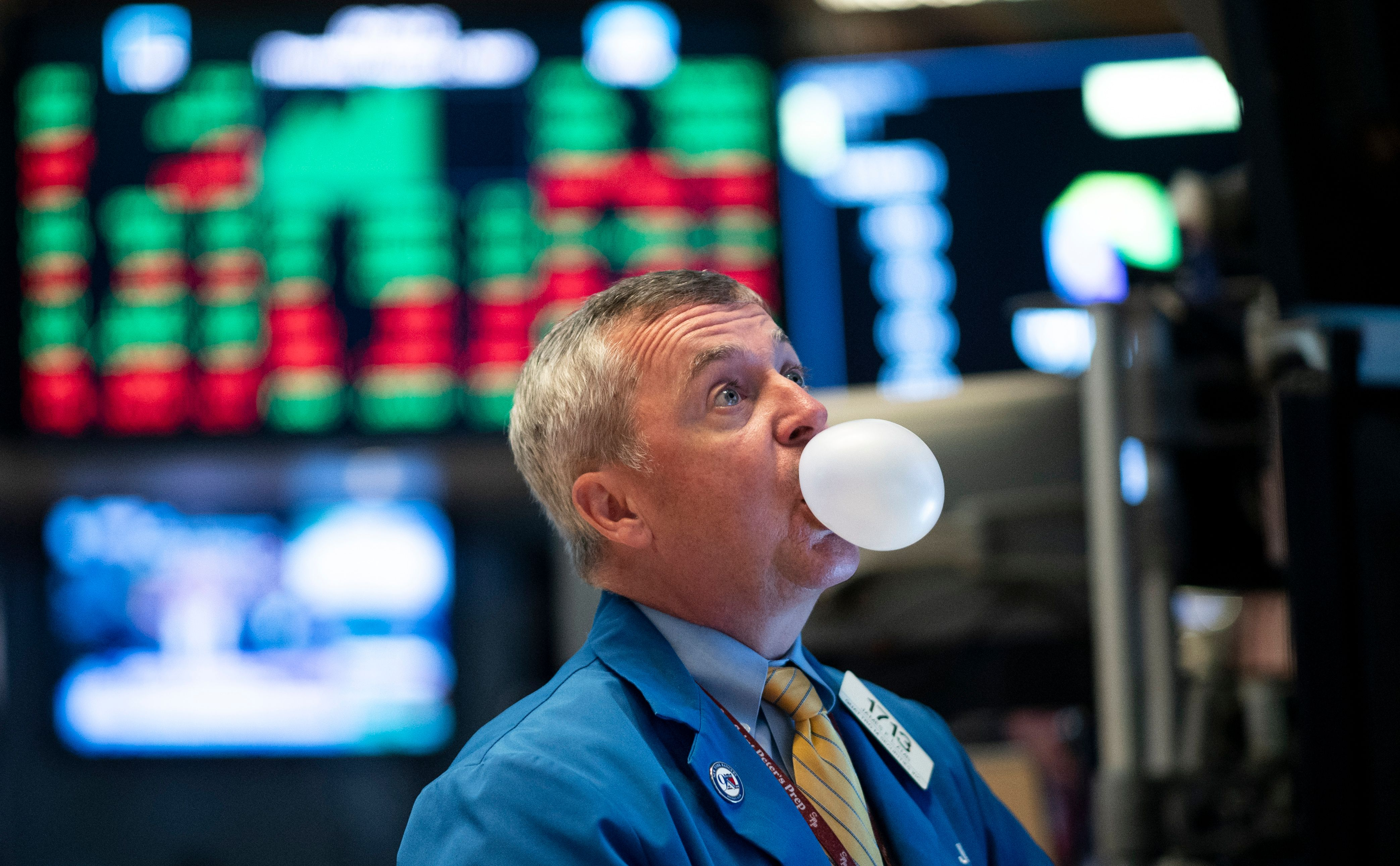 A stock trader blowing bubble gum on the trading floor.