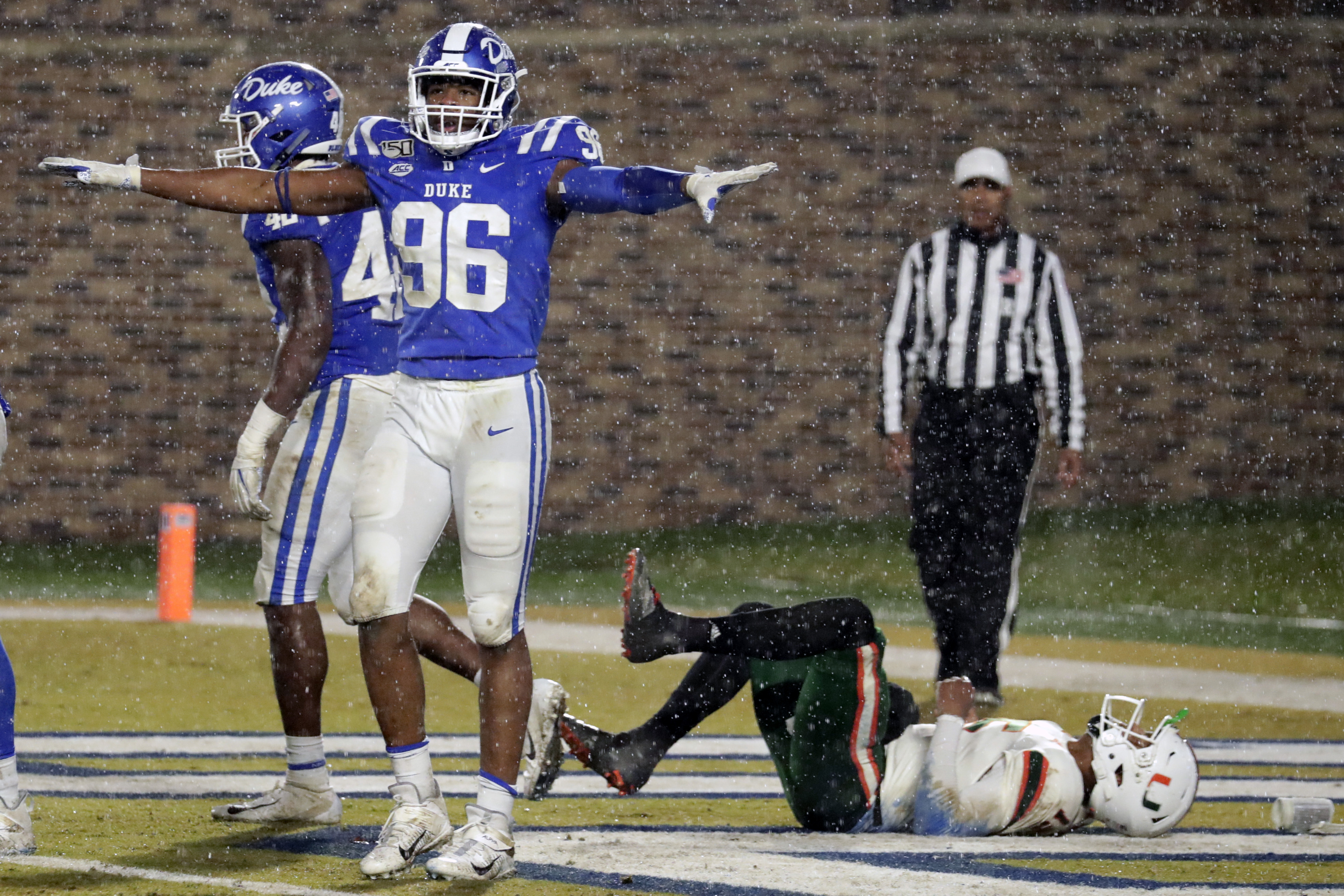 Duke's Chris Rumph II (96) celebrates in front of Miami's Jarren Williams (15) after Duke made a defensive stop during the third quarter of an NCAA college football game in Durham, N.C.in 2019.