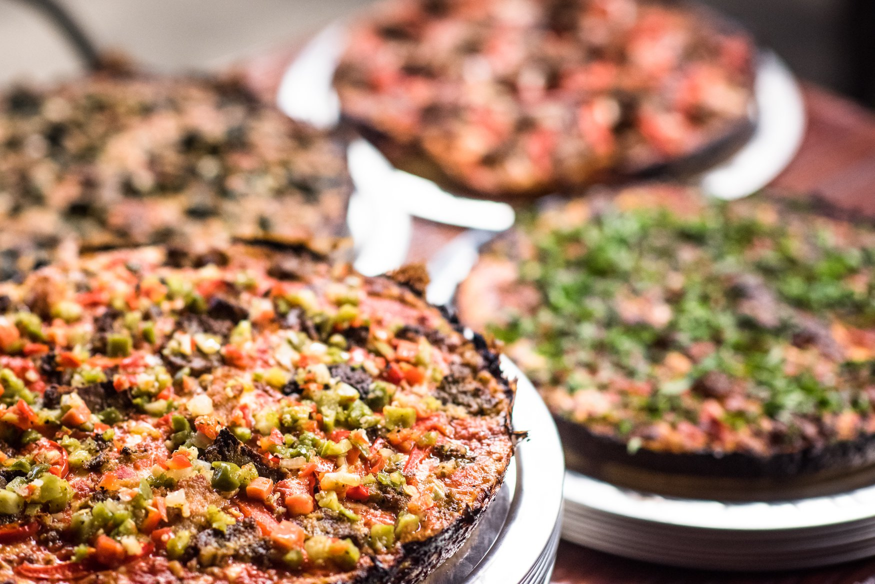 A selection of pizzas with various toppings at Windy City Pie