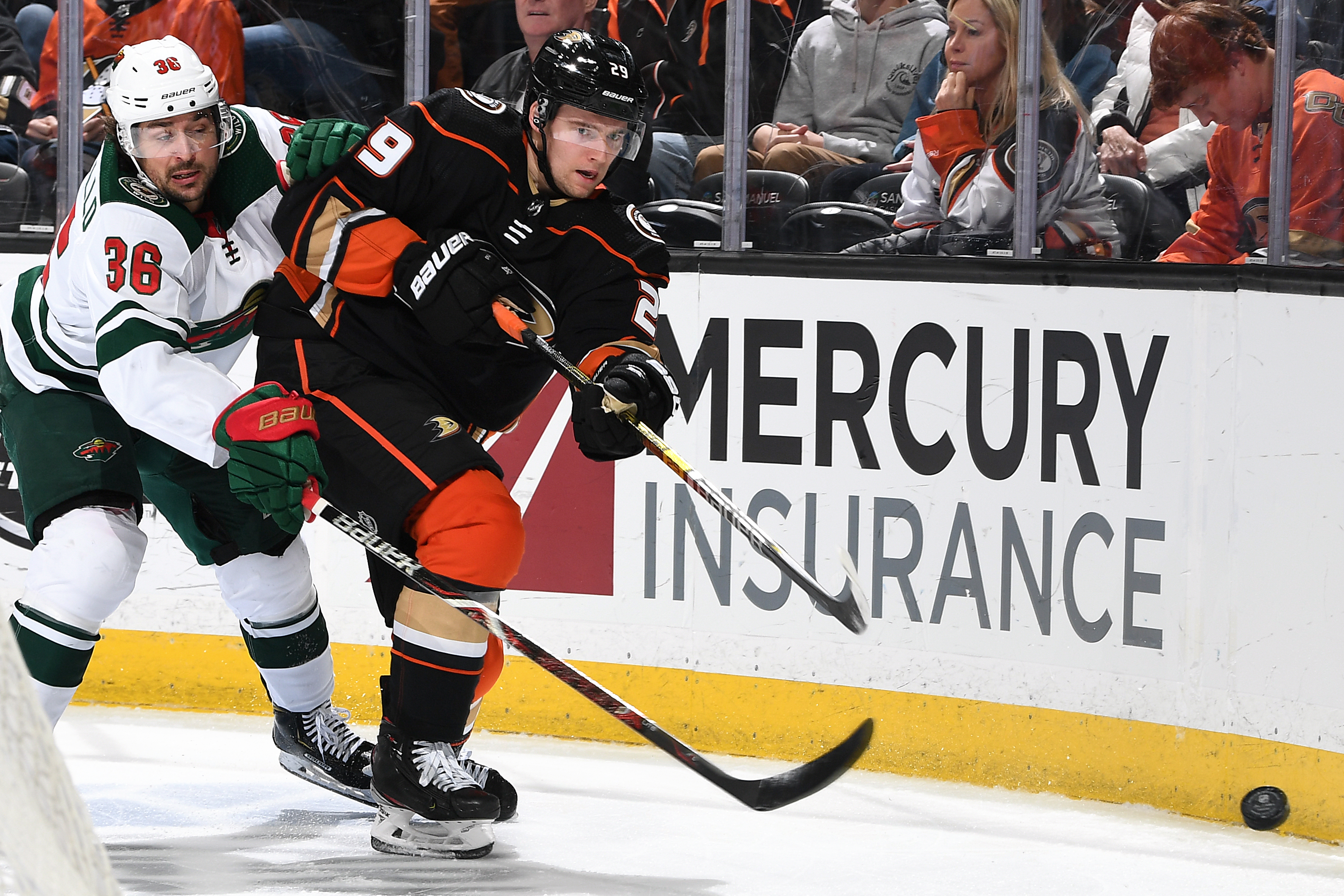 ANAHEIM, CA - MARCH 8: Christian Djoos #29 of the Anaheim Ducks battles for the puck against Mats Zuccarello #36 of the Minnesota Wild during the game at Honda Center on March 8, 2020 in Anaheim, California.