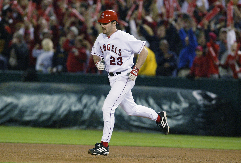 Scott Spiezio runs the bases after hitting a two run