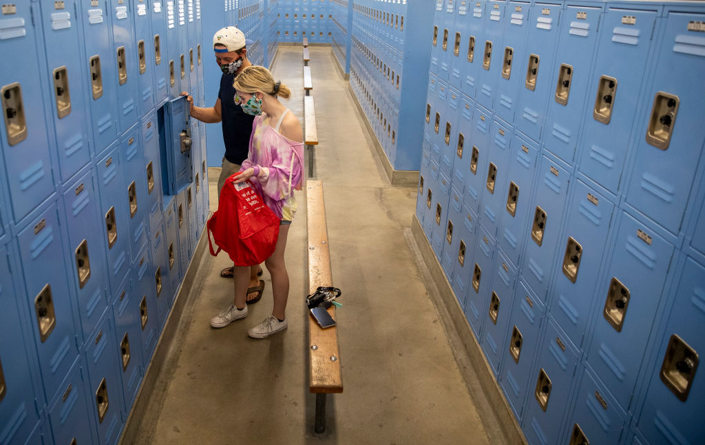 Senior Mason Wise, left, helps his sister Mackenzie, a sophomore, clean out her PE locker at El Camino Real Charter High School on April 30, 2020 in Woodland Hills, California.